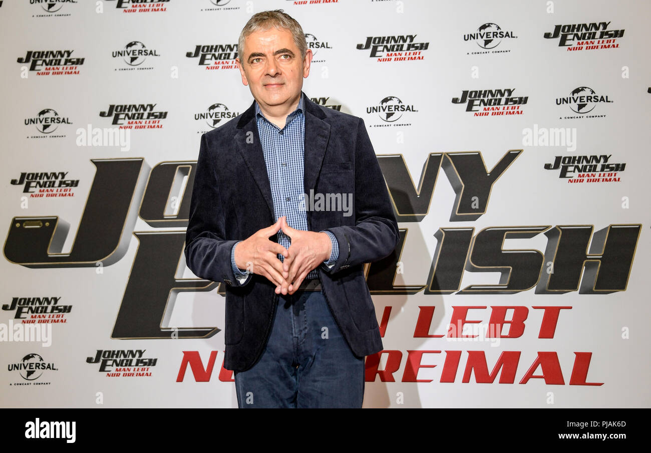 Hamburg, Germany. 06th Sep, 2018. 06.09.2018, Hamburg: Rowan Atkinson, British actor, stands in front of a wall in the Hotel The Fontenay with the writing of his new film 'Johnny English - You only live 3 times'. The film will be released in cinemas on October 18. Credit: Axel Heimken/dpa/Alamy Live News - Stock Image