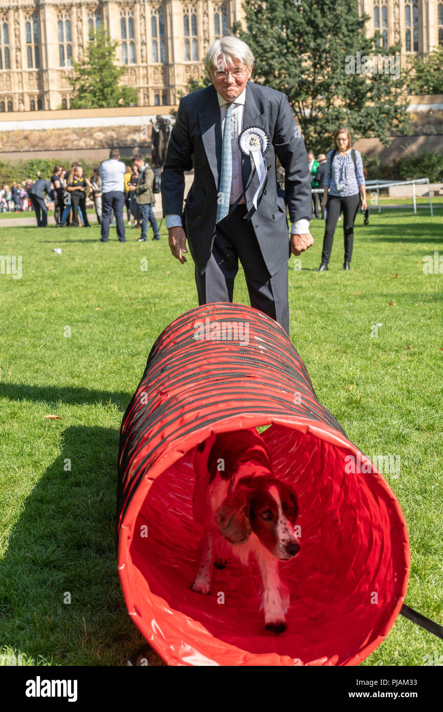 London, UK. 6th September 2018 Westminster Dog of the year event in Victoria Tower Gardens, London, UK. Andrew Mitchell MP with his dog Scarlet Credit Ian Davidson/Alamy Live News Stock Photo