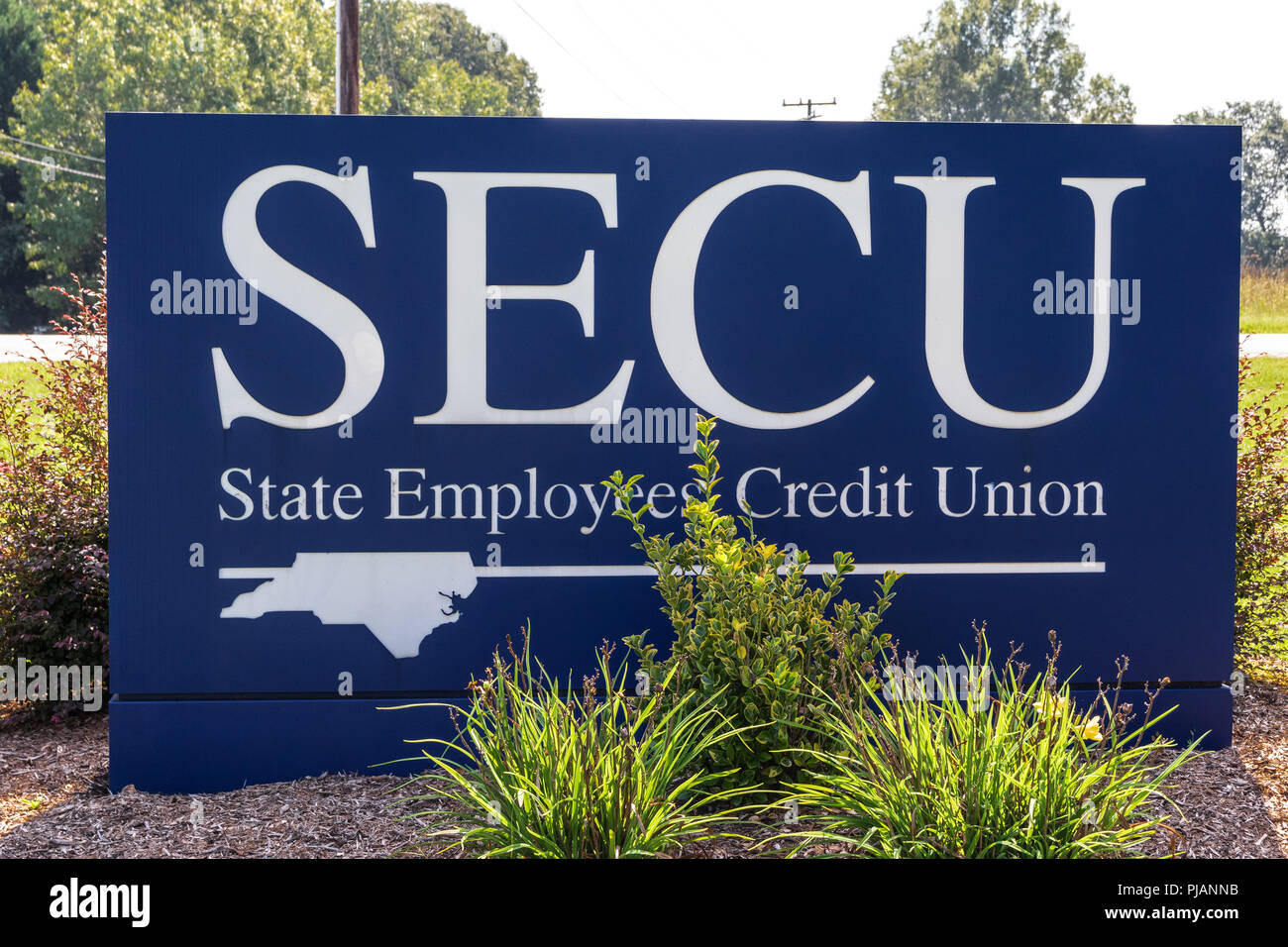 HICKORY, NC, USA-9/2/18: A  street sign at a branch of the North Carolina State Employees' Credit Union. - Stock Image