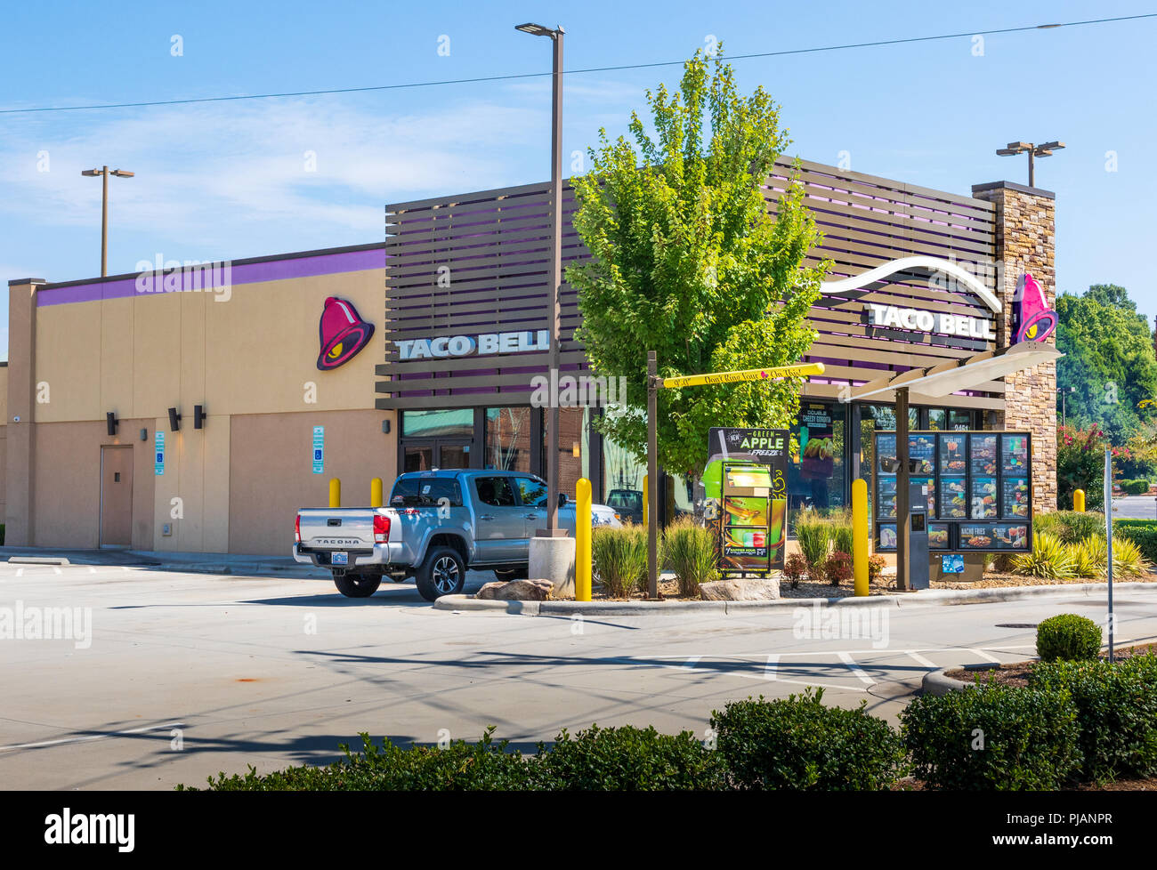 HICKORY, NC, USA-9/2/18: A Taco Bell restaurant in Hickory, NC, showing the drive-thru, and one pickup truck parked in lot. No people are visible. Stock Photo