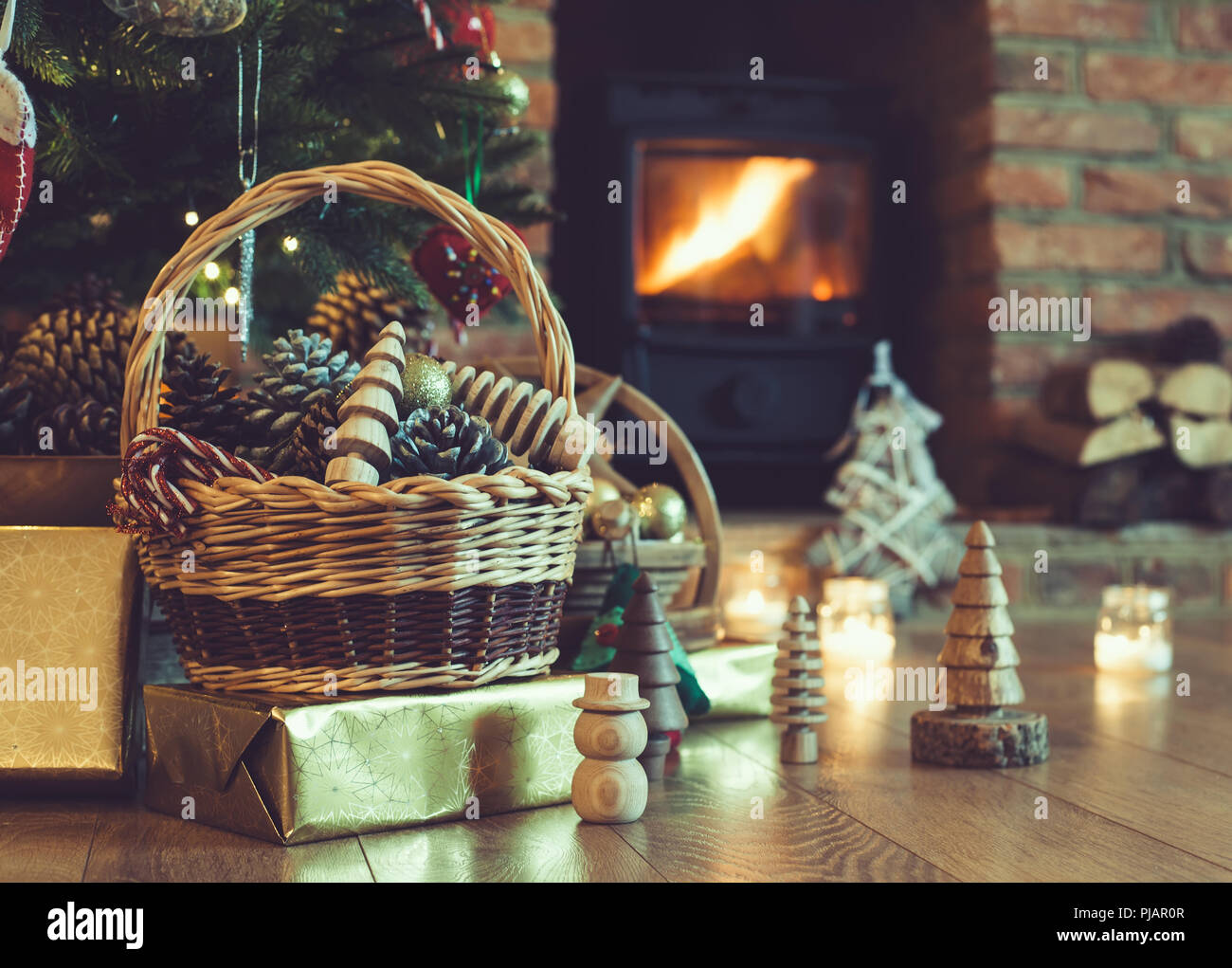 Christmas Decorations In The Basket In Front Of Fireplace With