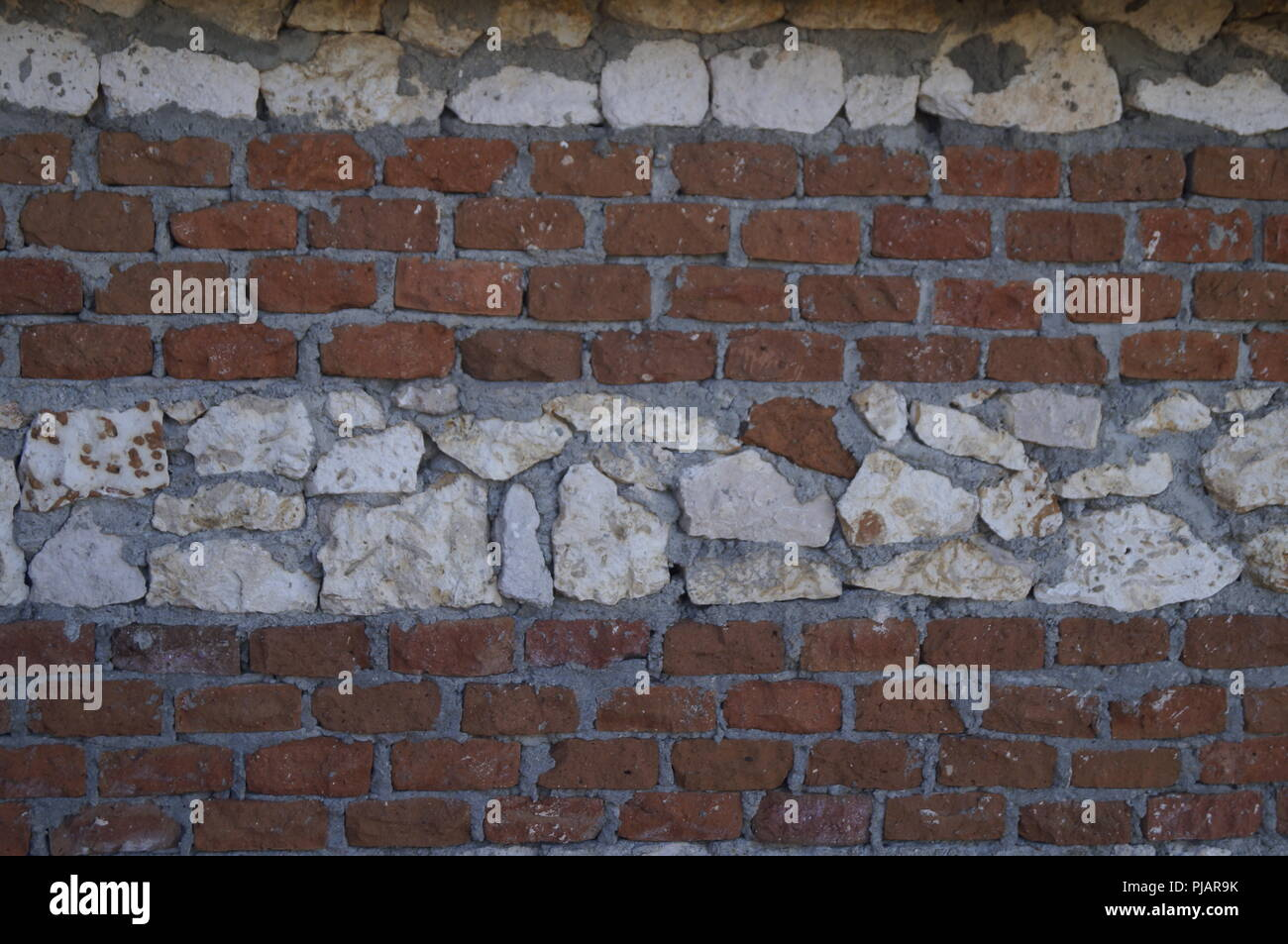 Stone and bricks wall background - Stock Image