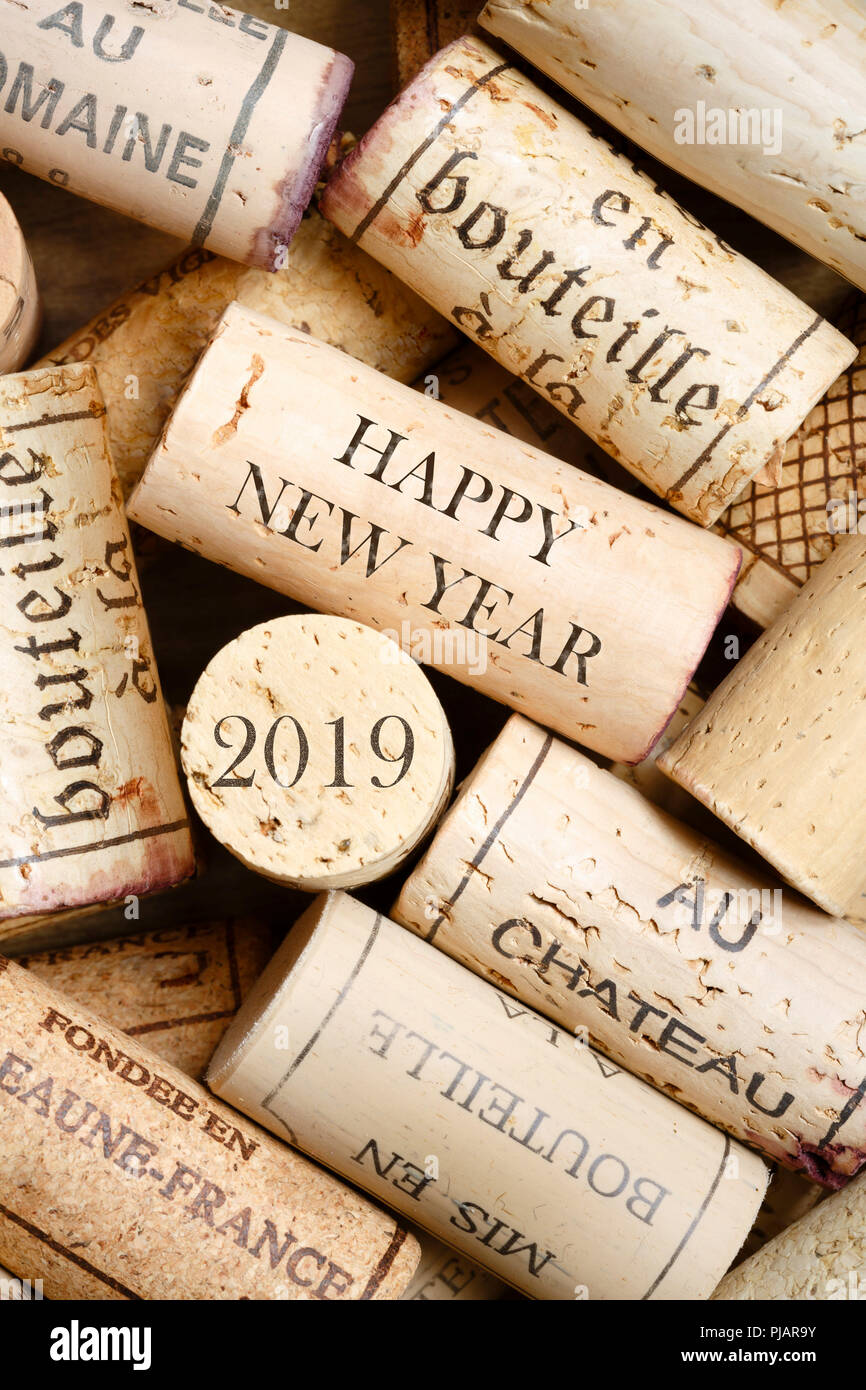 Happy New Year 2019 greeting card with wine corks. No visible trademarks - Stock Image