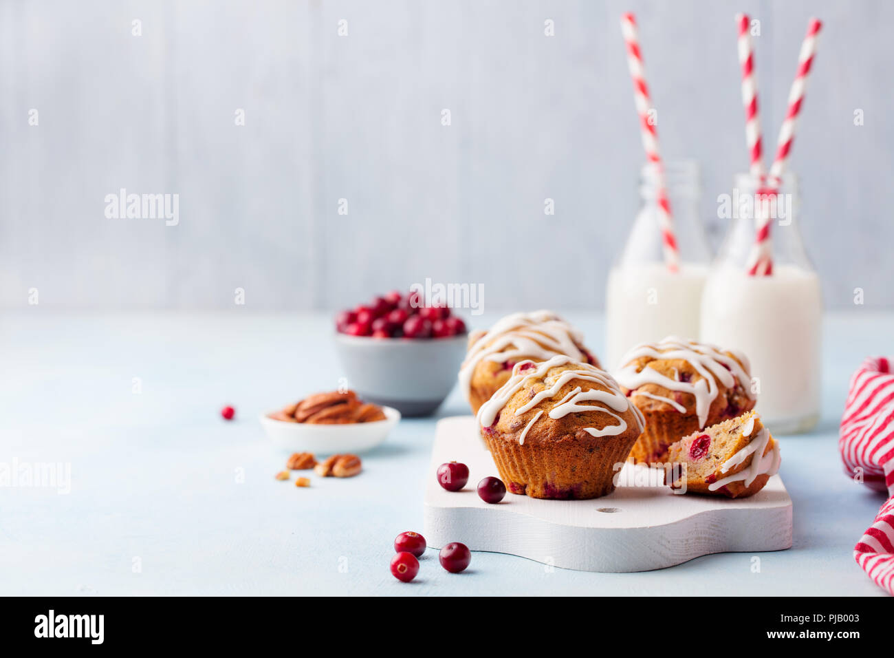 Muffins, cakes with cranberry and pecan nuts. Christmas decoration. Copy space. - Stock Image