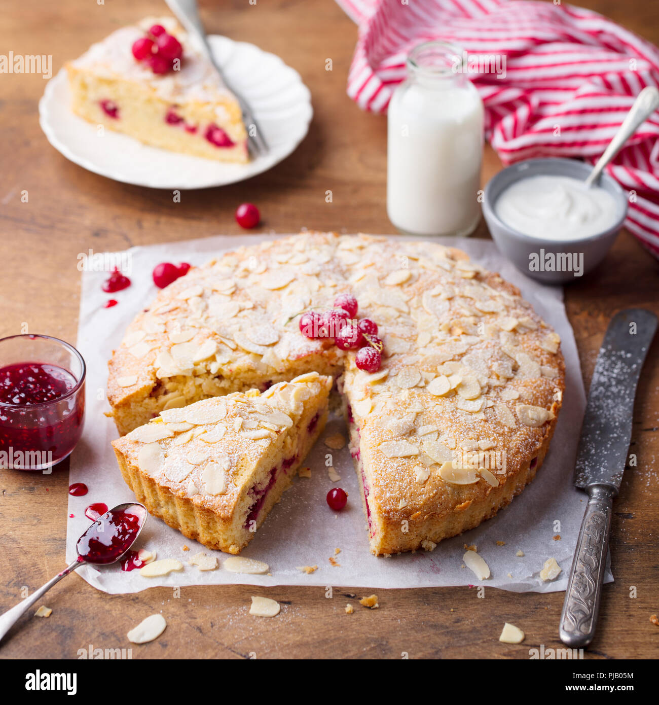 Almond and raspberry cake, Bakewell tart. Traditional British pastry. Wooden background. - Stock Image