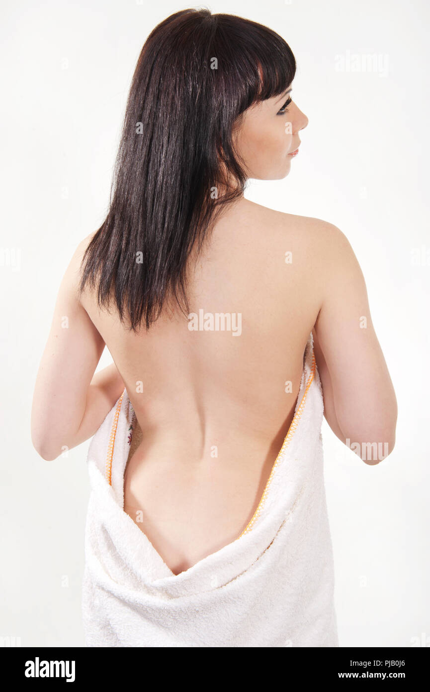 Girl in a towel on a white background - Stock Image