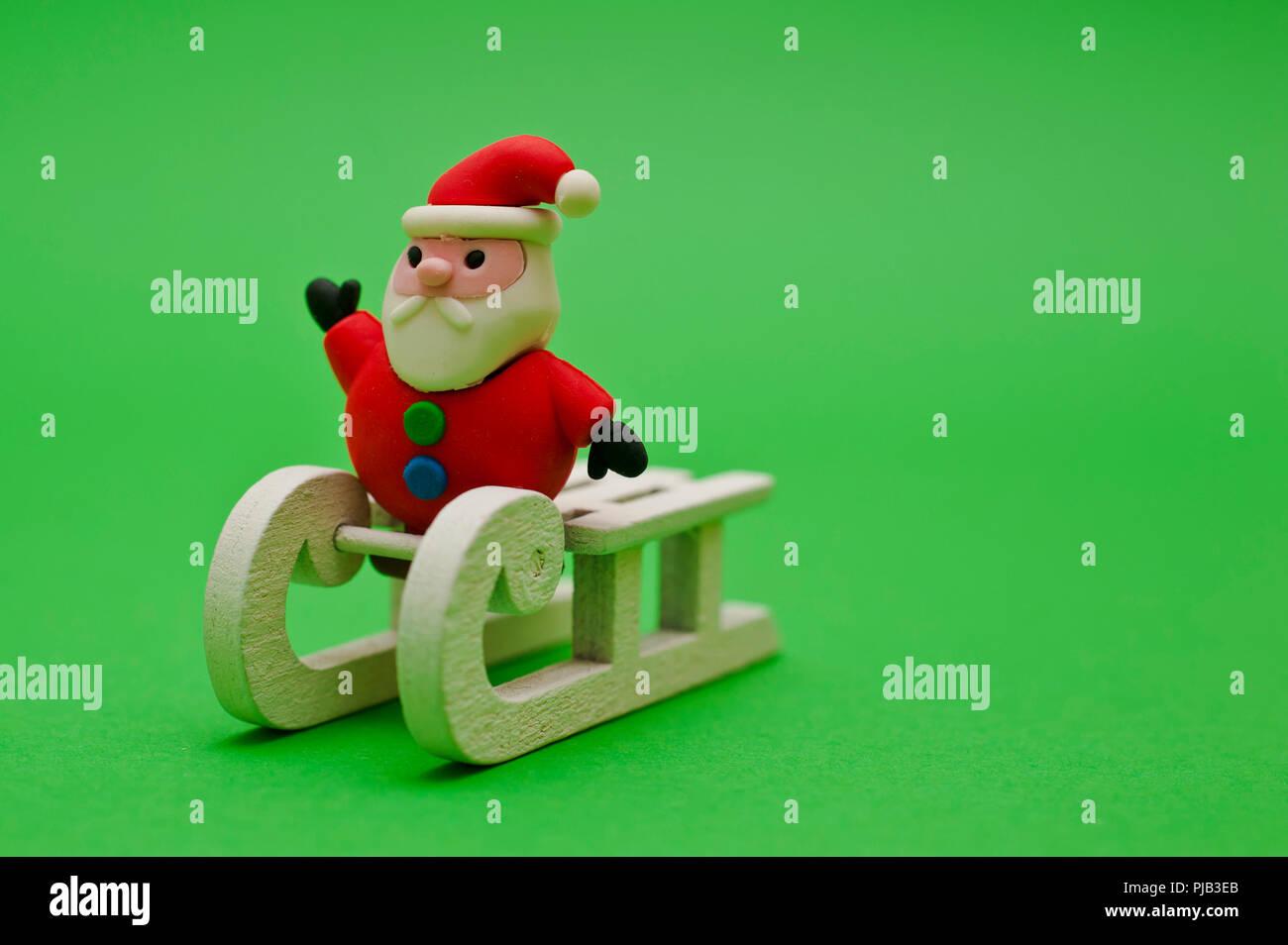 Santa Claus miniature figurine on a sledge - Stock Image