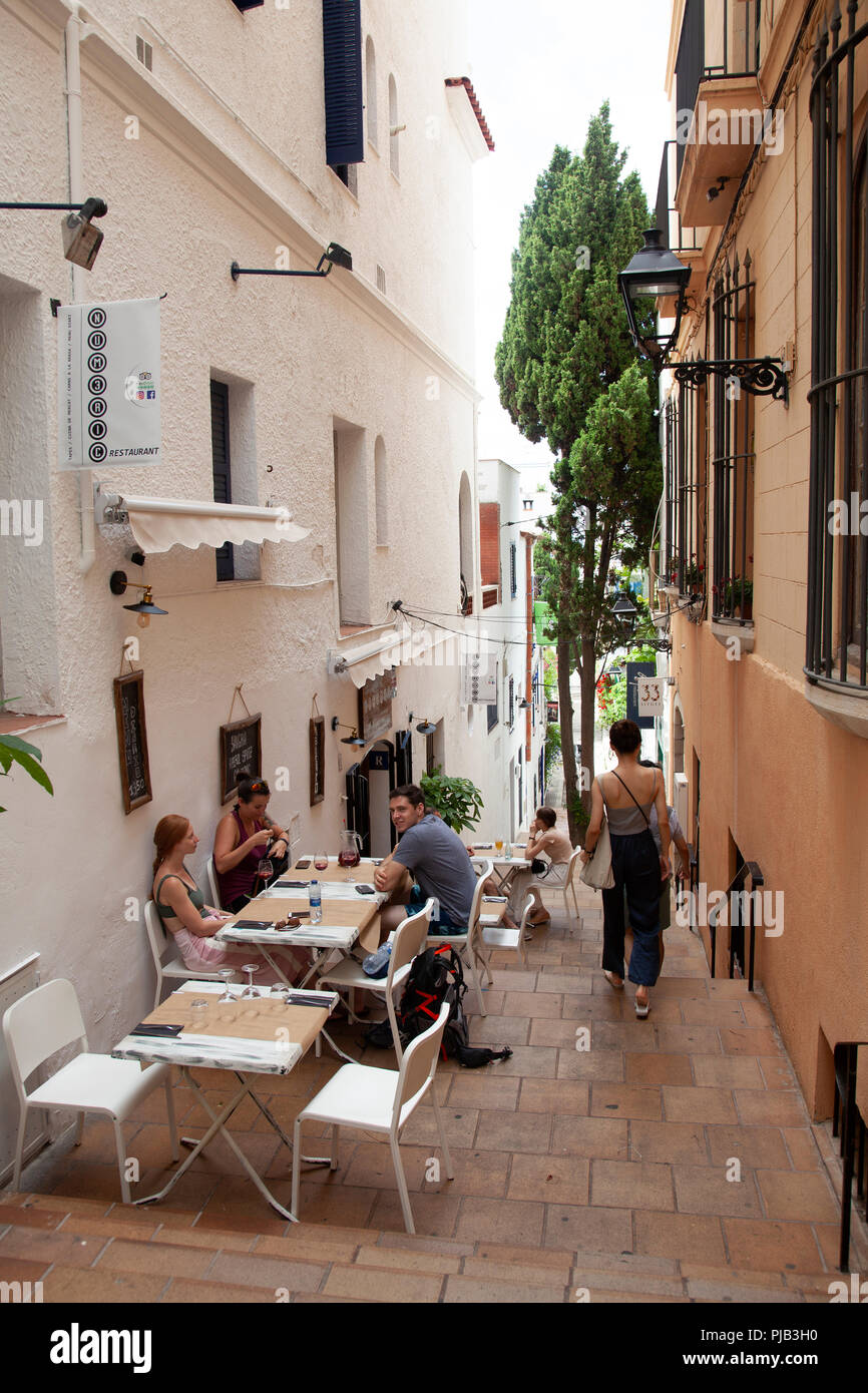 Numeric Restaurant in Alleyway in Sitges, Spain - Stock Image