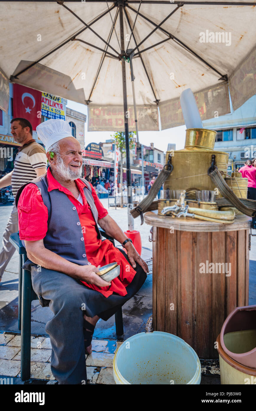 Unidentified man sells Meyan serbeti(Glycyrrhiza glabra sherbet) or Liquorice made from root of Glycyrrhiza glabra.Sanliurfa,Turkey.19 July 2018 - Stock Image