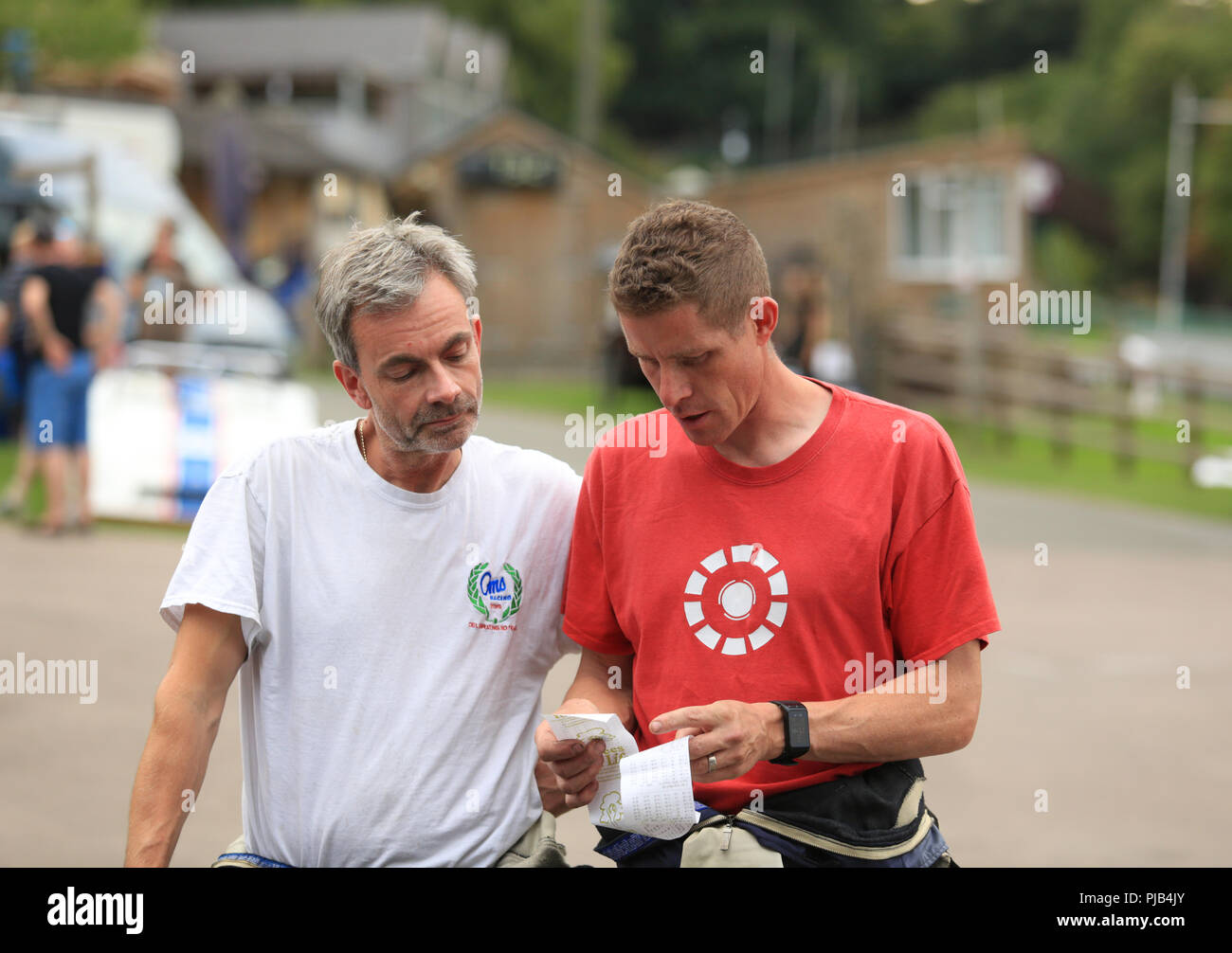 Trevor Willis (in white) three times British hill climb champion chats with 6 times British hill climb champion Scott Moran (in red). - Stock Image