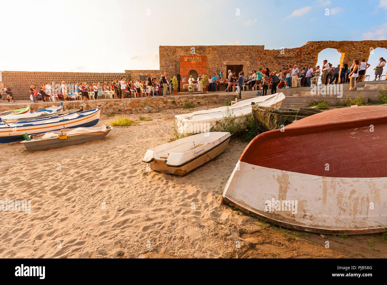 CEFALU / SICILY - SEPTEMBER 15, 2011: Catholic mess at the beach, shot taken at dusk after sunset - Stock Image