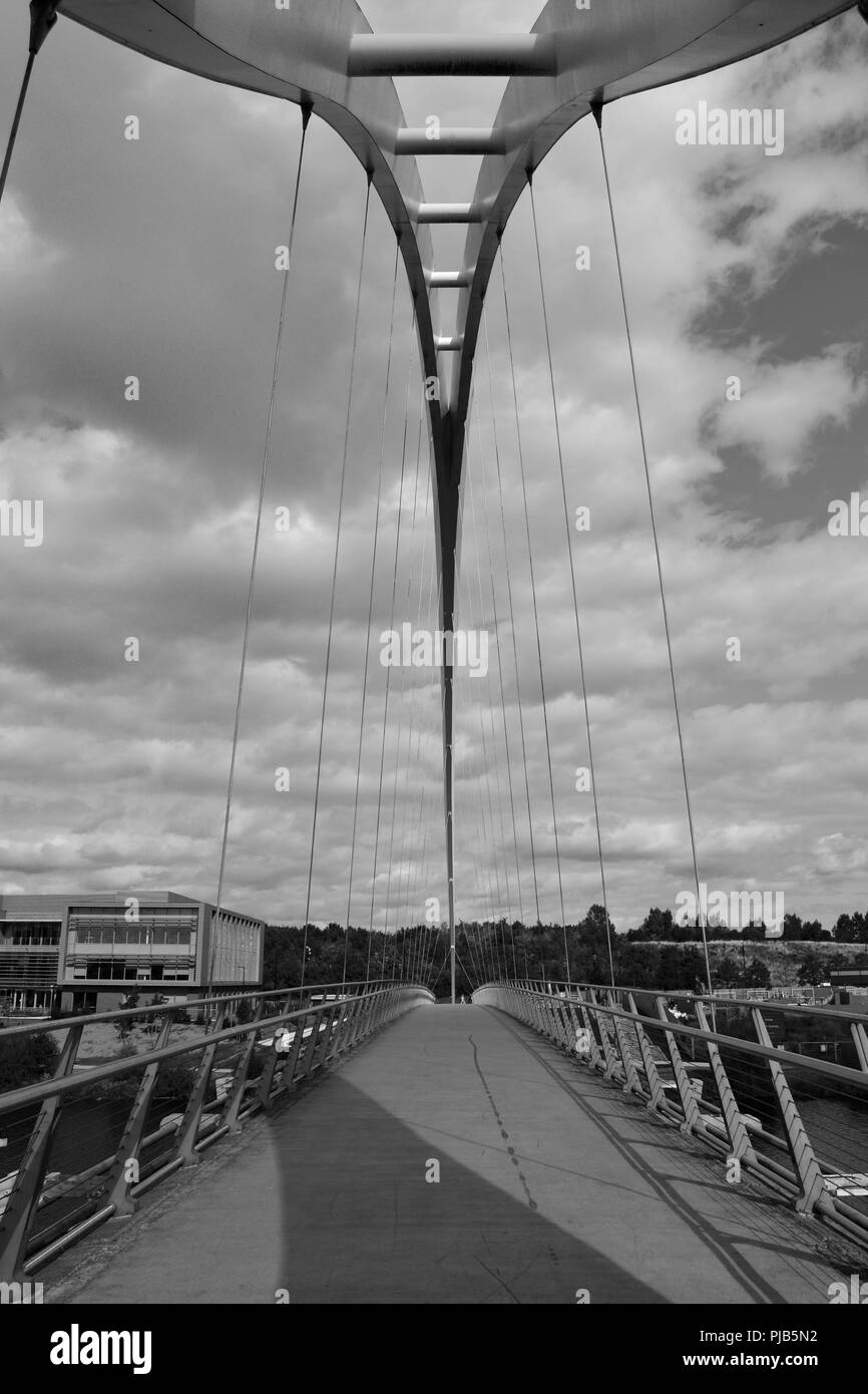 Striking black and white, naturally lit image of the iconic Infinity Bridge spanning the River Tees in Stockton-on-Tees, UK. Stock Photo