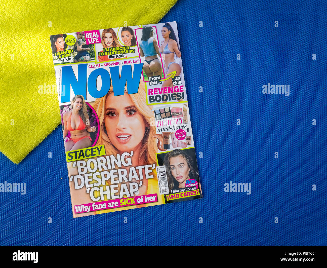Copy of Now Magazine on a Sunbed, Now magazine is a weekly celebrity news round-up aimed at women readers, The magazine was launched in 1996. - Stock Image