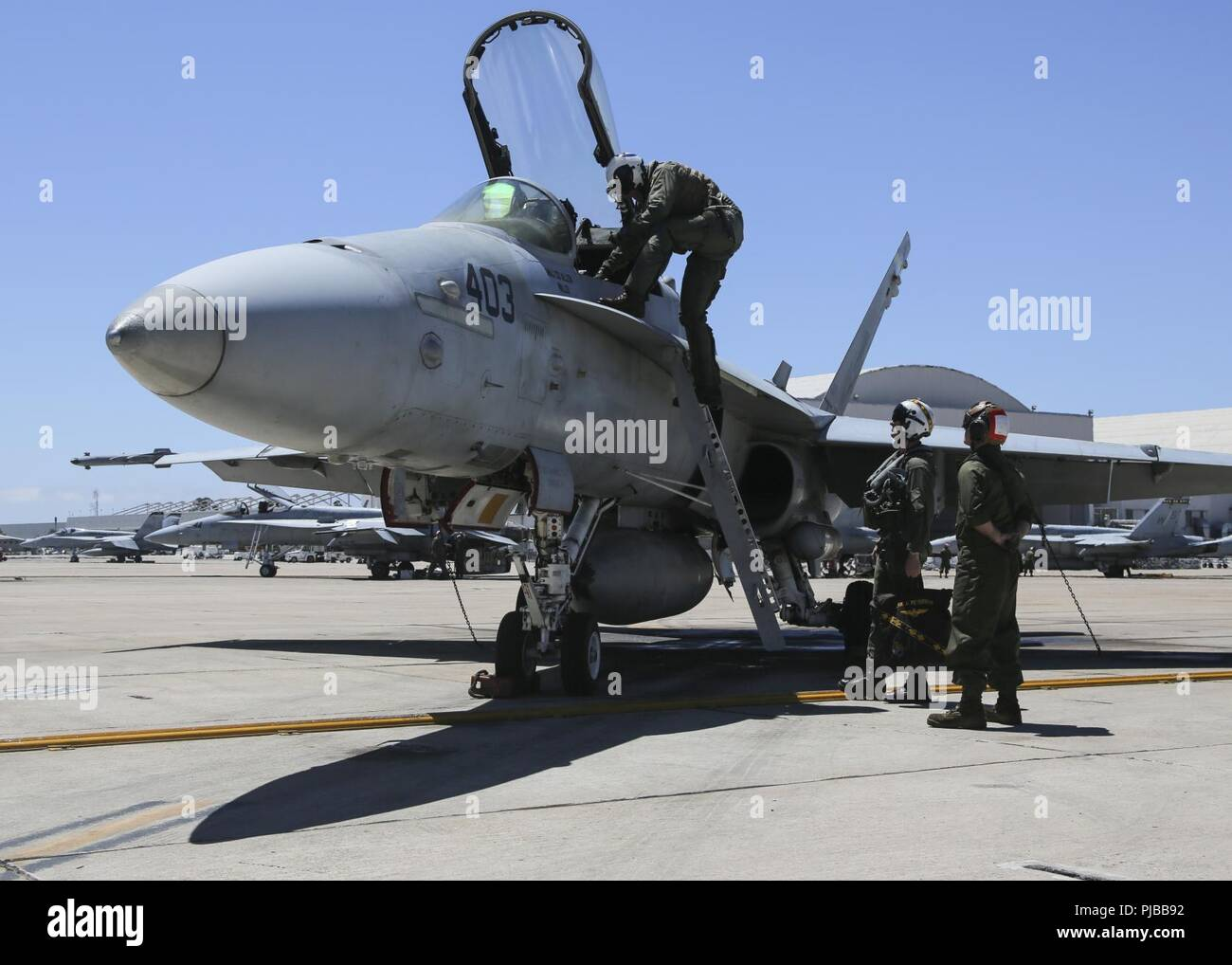 Maj. Gen. Mark R. Wise, the commanding general for 3rd Marine Aircraft Wing, climbs into an F/A-18C Hornet, during his final flight on Marine Corps Air Station Miramar, San Diego, Calif., July 02. Maj. Gen Wise flew for the last time as the commanding general of 3rd MAW. Stock Photo