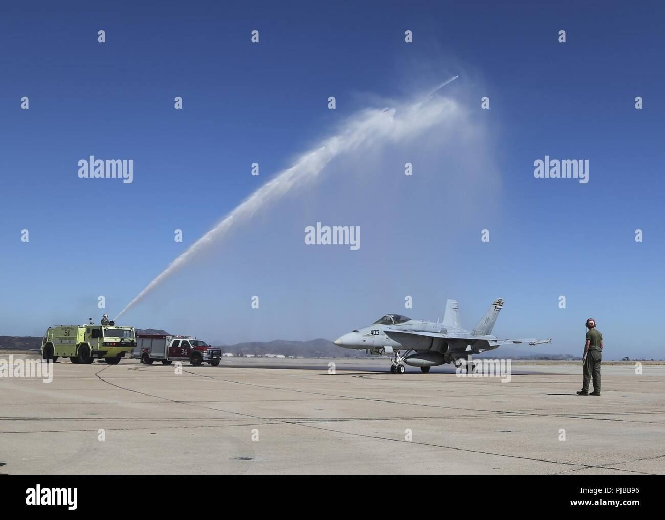 Maj. Gen. Mark R. Wise, the commanding general for 3rd Marine Aircraft Wing, is sprayed with water to celebrate his return from his final flight in an F/A-18C Hornet at Marine Corps Air Station Miramar, San Diego, Calif., July 02. Maj. Gen. Wise flew for the last time as the commanding general of 3rd MAW. Stock Photo