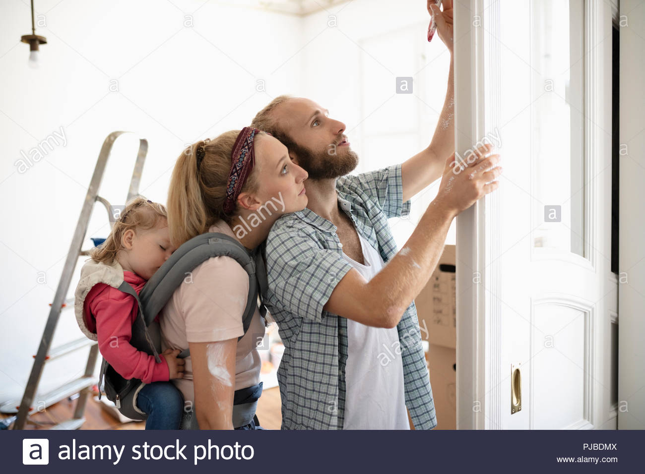Affectionate young family painting - Stock Image