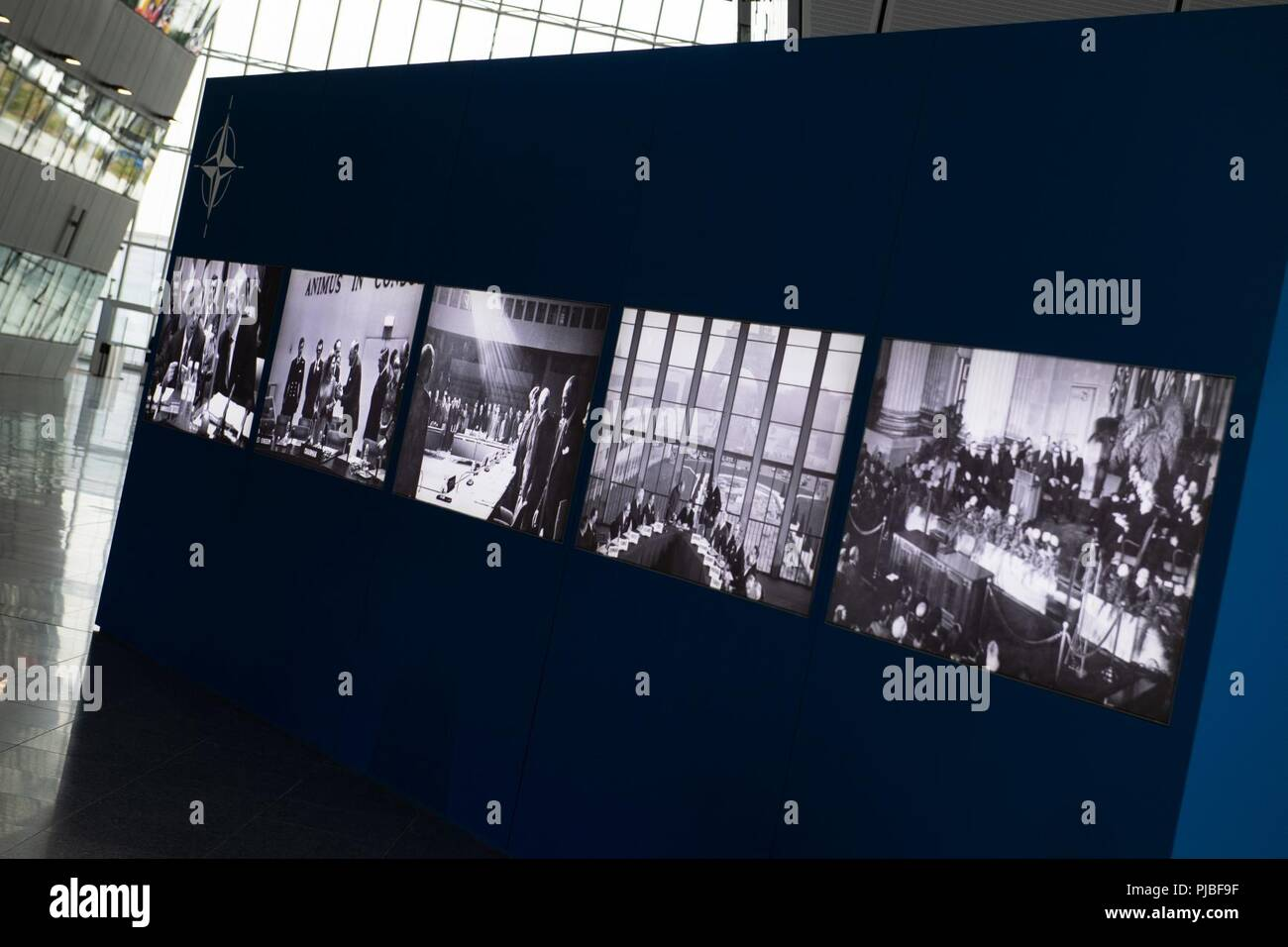 A display illuminates with historical photos of NATO during the Brussels Summit at NATO HQ, Brussels, Belgium, July 11, 2018. The Brussels Summit is the most recent iteration of the gathering of the North Atlantic Council when NATO heads of state and government join to discuss and decide the future of the Alliance. (NATO - Stock Image