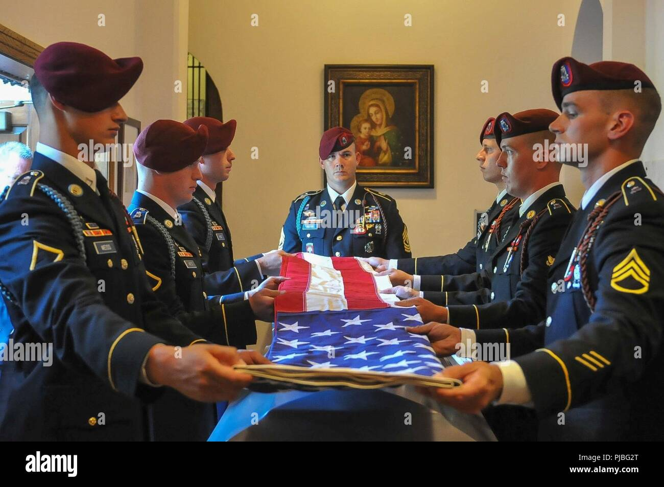 The flag of the United States is folded over the casket of the late retired 1st Sgt. Harold Eatman by paratroopers of the 2nd Battalion, 505th Parachute Infantry Regiment on July 11, 2018 at the Cathedral of Saint Patrick in Charlotte, North Carolina as 1st Sgt. James Miller of Company B, 2-505 PIR, center, looks on.  Eatman was a member of the 505th PIR and conducted four World War II combat jumps into Sicily, Salerno, Normandy and Holland with the regiment.  He died earlier in July at the age of 102. Stock Photo