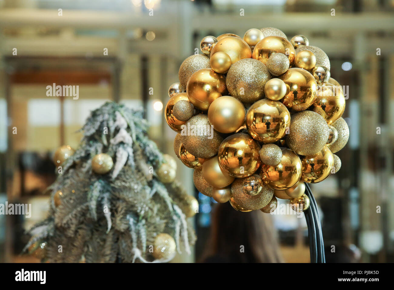 new year background new years round golden balls christmas balls close up picture three golden christmas sparkling balls against