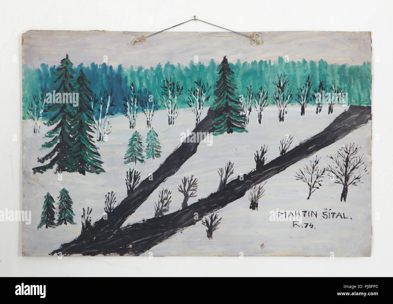 Winter landscape painting by Czech naïve painter Martin Šítal (1974) on display at the permanent exhibition devoted to naïve art by Martin Šítal (1901-1983) and his wife Marie Šítalová (1904-1979) entitled 'The Painted World of the Šital Family' ('Malovaný svět manželů Šítalových') in the Kantůrkovec Museum in Velešín, South Bohemia, Czech Republic. - Stock Image