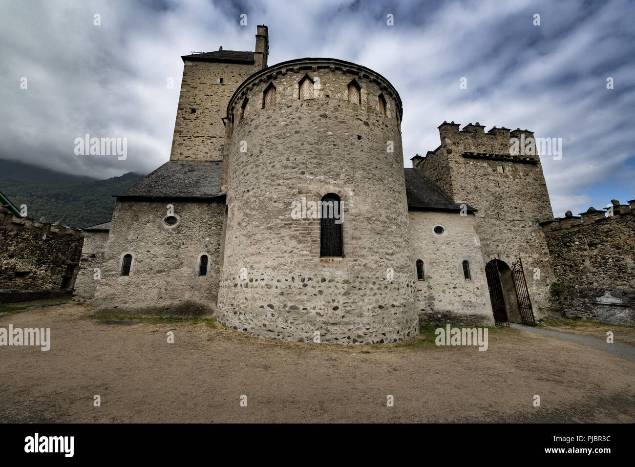 Fortified medieval church of the Templars situated in the french Pyrénées mountains, it's graveyard containing Knights of the Templars. Stock Photo