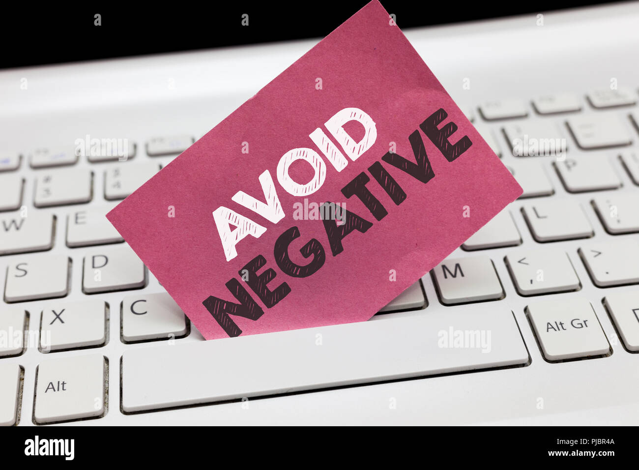 Conceptual hand writing showing Avoid Negative. Business photo showcasing Staying away from pessimistic people Suspicious Depression. - Stock Image