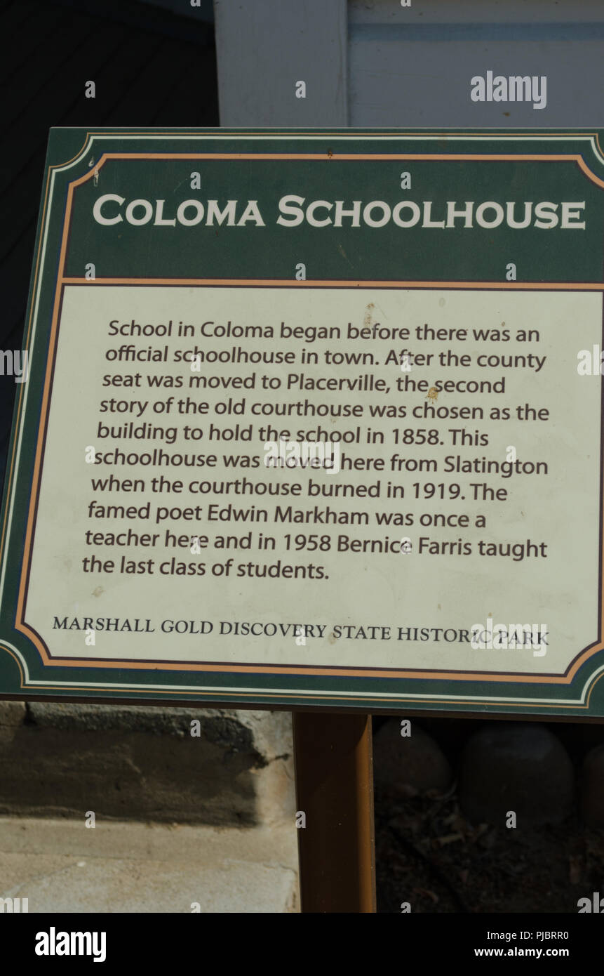 Sign tells the sotry of the Coloma schoolhouse - Stock Image