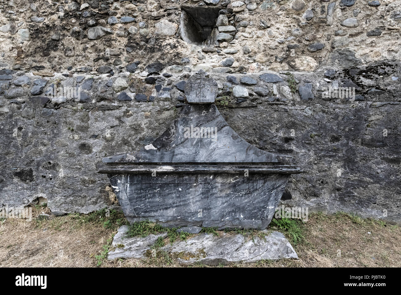 Fortified medieval church of the Templars situated in the french Pyrénées mountains, it's graveyard containing Knights of the Templars. - Stock Image