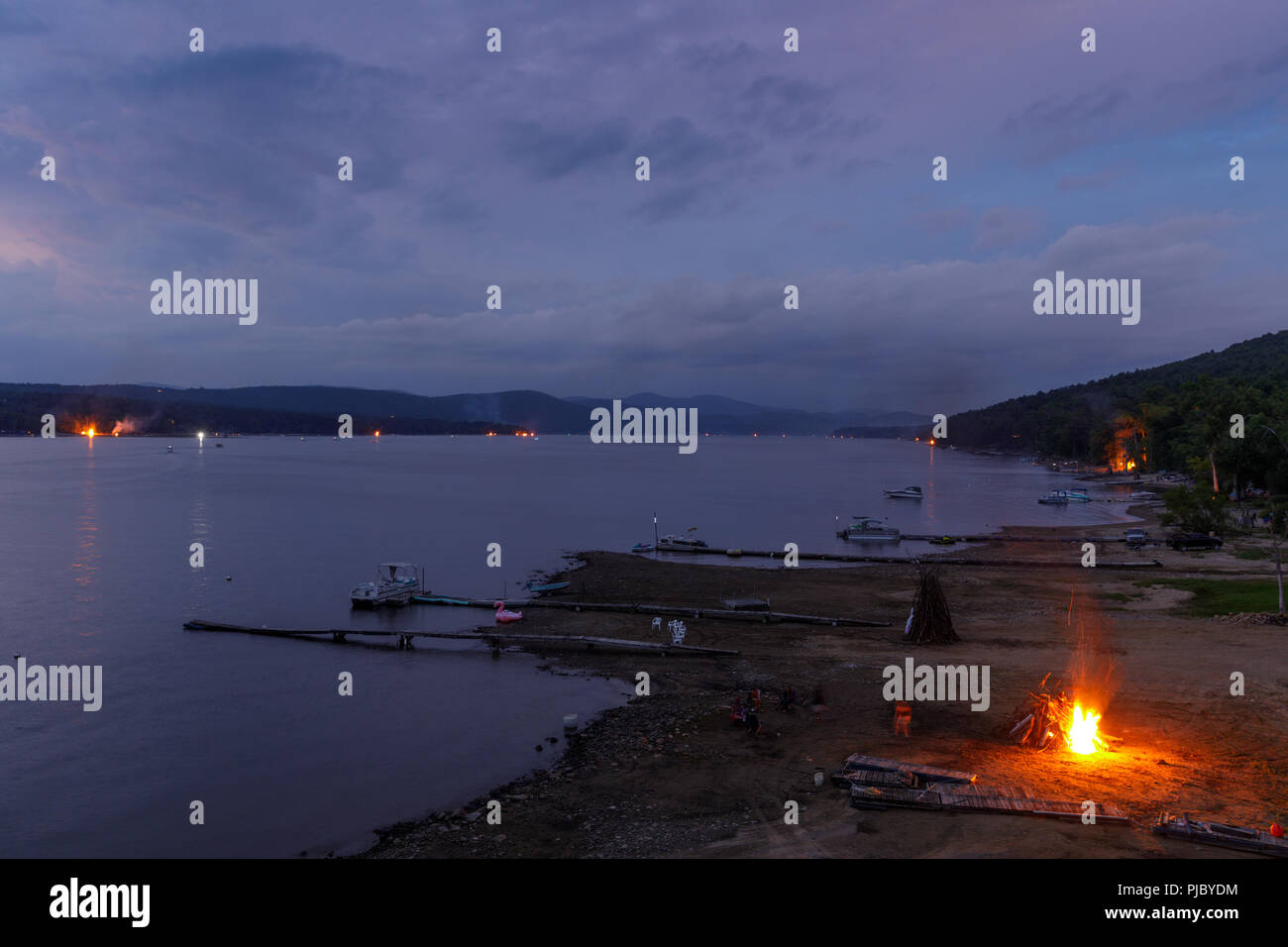 "Summer ends with a ""Ring of Fire"" on Labor Day weekend, bonfires lit along the shores of Great Sacandaga Lake, southern Adirondacks, New York State. Stock Photo"