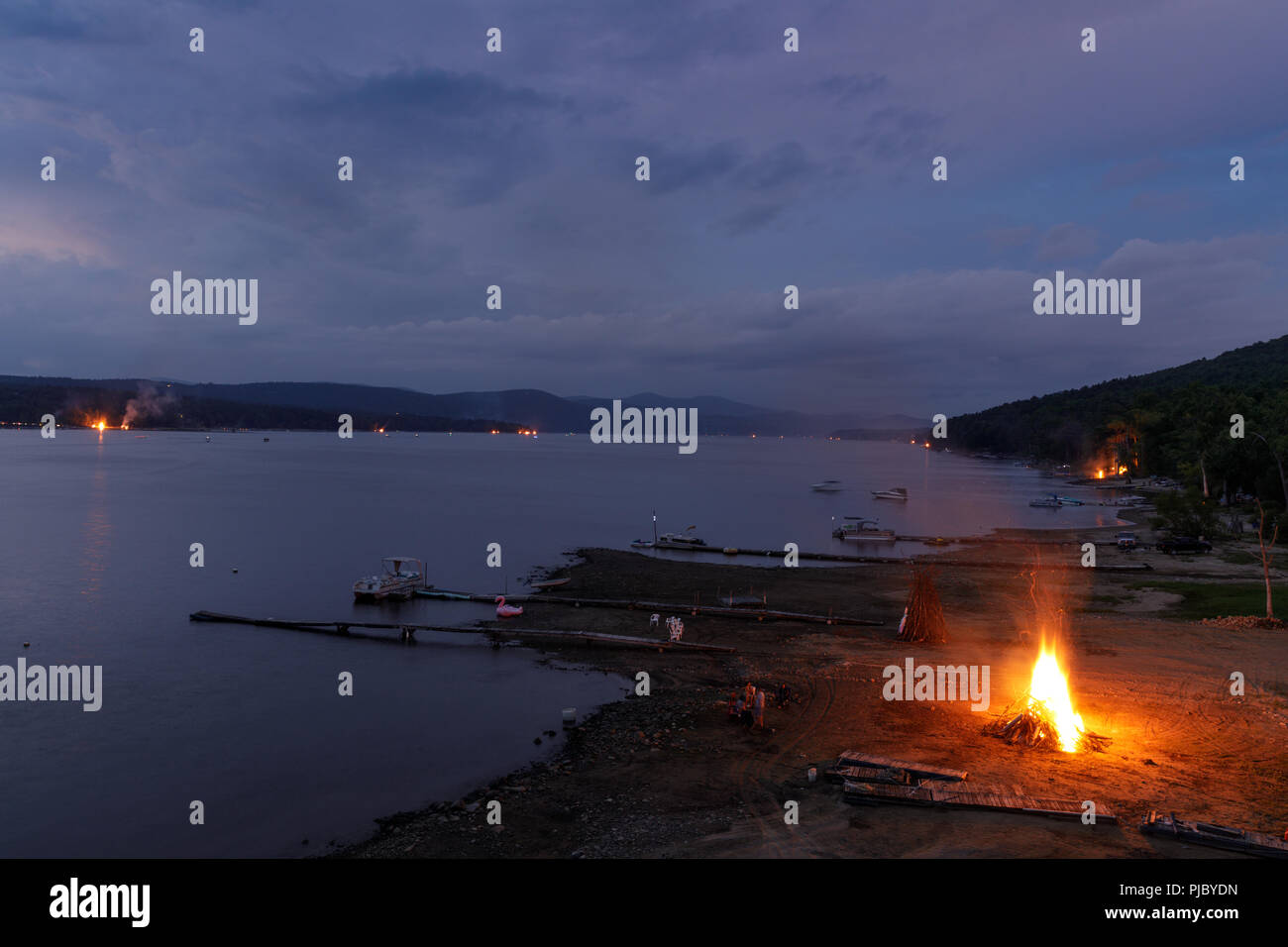 Summer ends with a 'Ring of Fire' on Labor Day weekend, bonfires lit along the shores of Great Sacandaga Lake, southern Adirondacks, New York State. - Stock Image