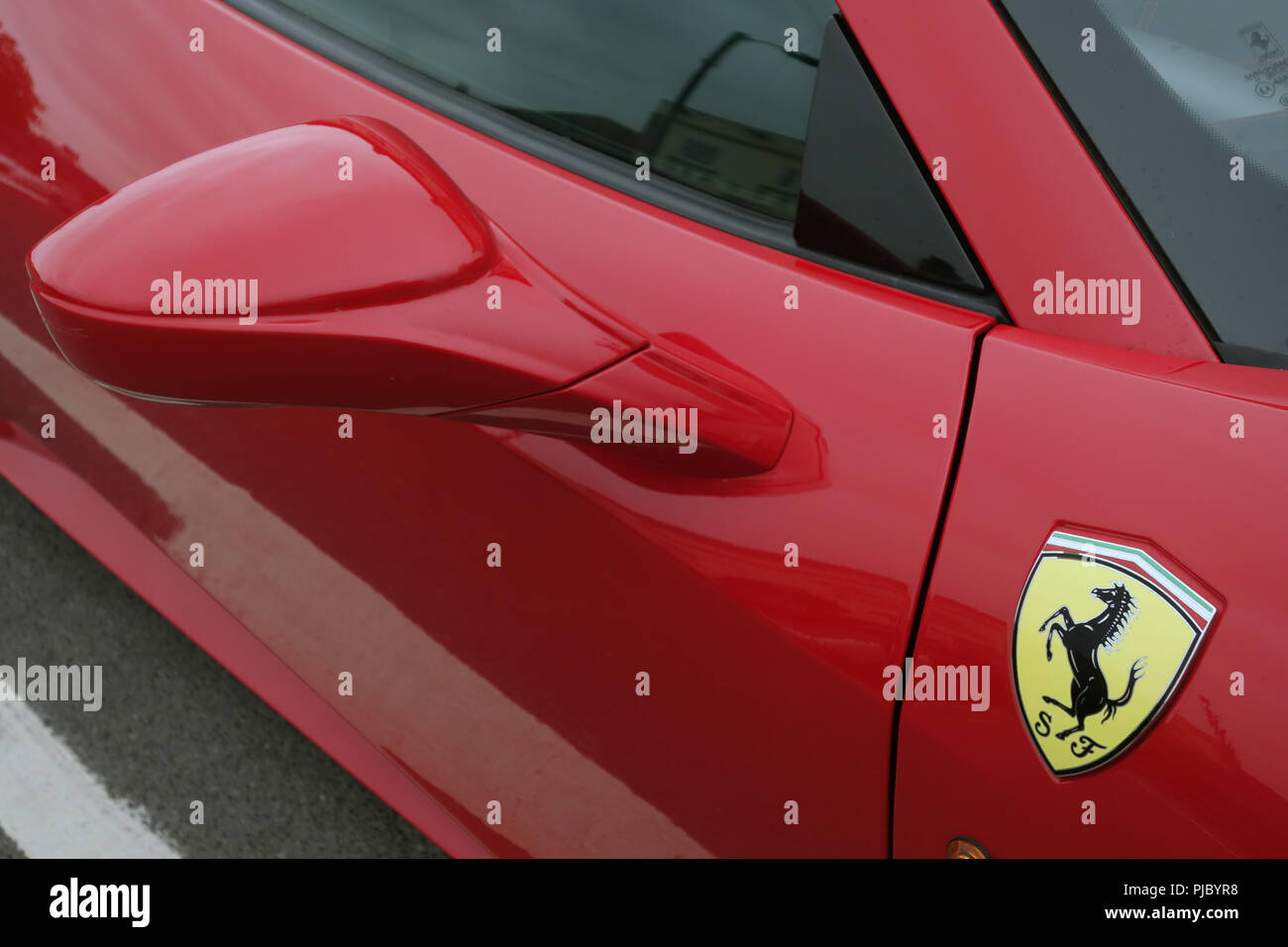 8d730987e87c5 Closeup of wing mirror and iconic badge on a Red Ferrari 458 Spider in  Bawtry,