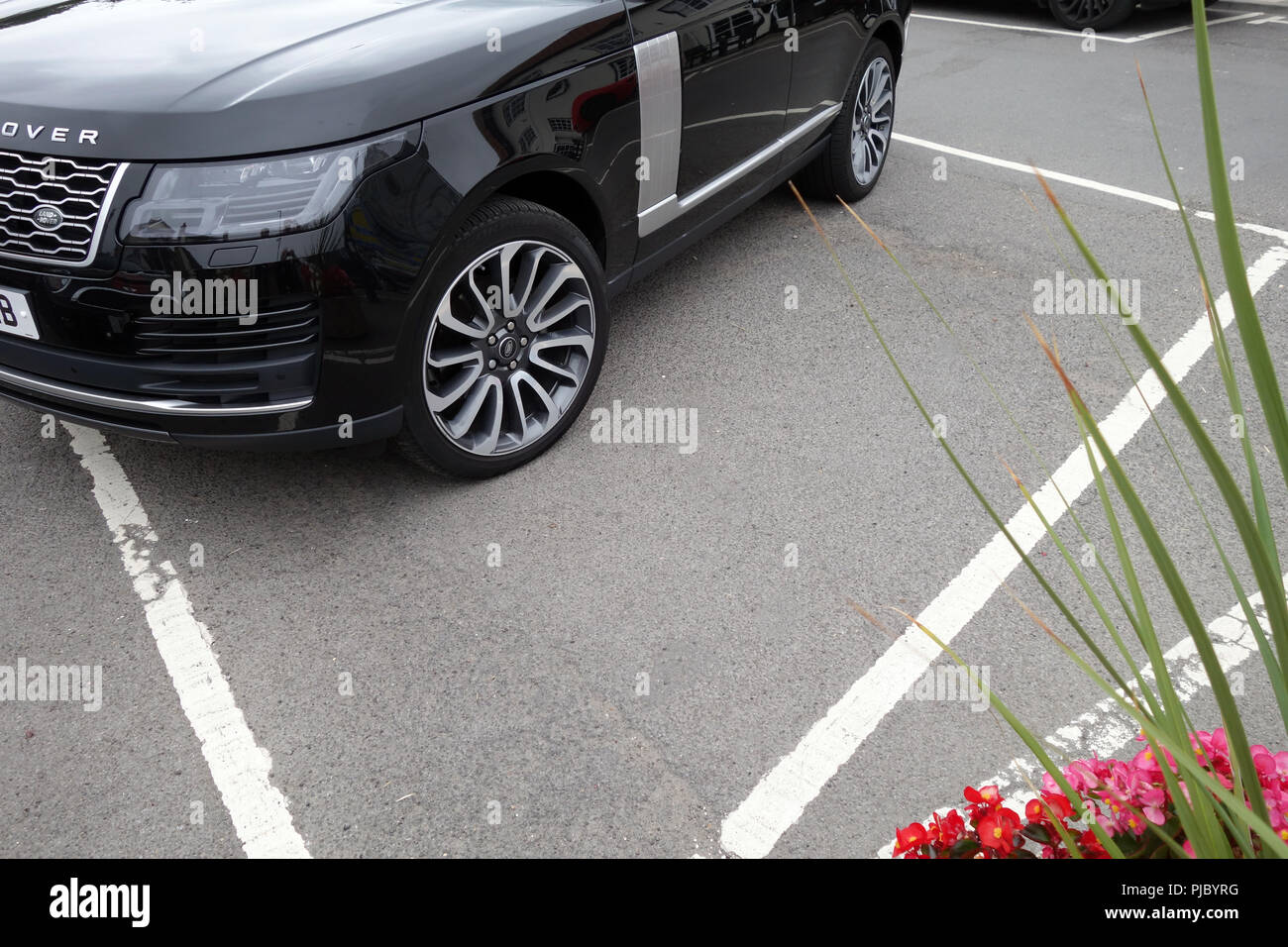 Badly Parked Range Rover in parking bay - Stock Image