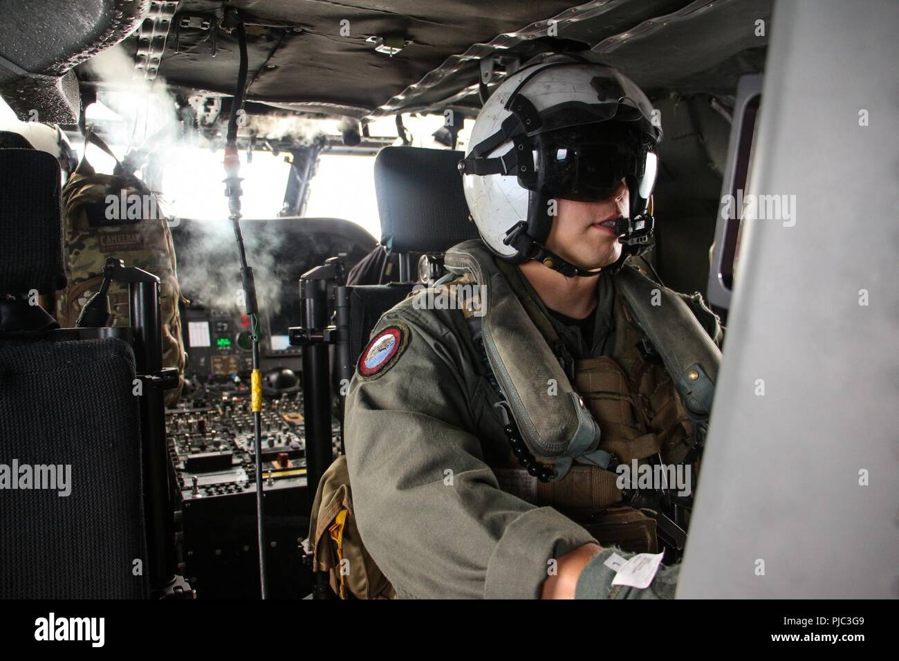 PACIFIC OCEAN (July 12, 2018) Naval Aircrewman (Helicopter) 1st Class Alejandro Vega, assigned to the 'Blackjacks' of Helicopter Sea Combat Squadron (HSC) 21,  operates an Advanced Laser Mine Detection System (ALMDS) console aboard an MH-60S Sea Hawk helicopter during Rim of the Pacific (RIMPAC) exercise in the Southern California area of operations. Twenty-five nations, 46 ships, five submarines, about 200 aircraft, and 25,000 personnel are participating in RIMPAC from June 27 to Aug. 2 in and around the Hawaiian Islands and Southern California. The world's largest international maritime exer - Stock Image