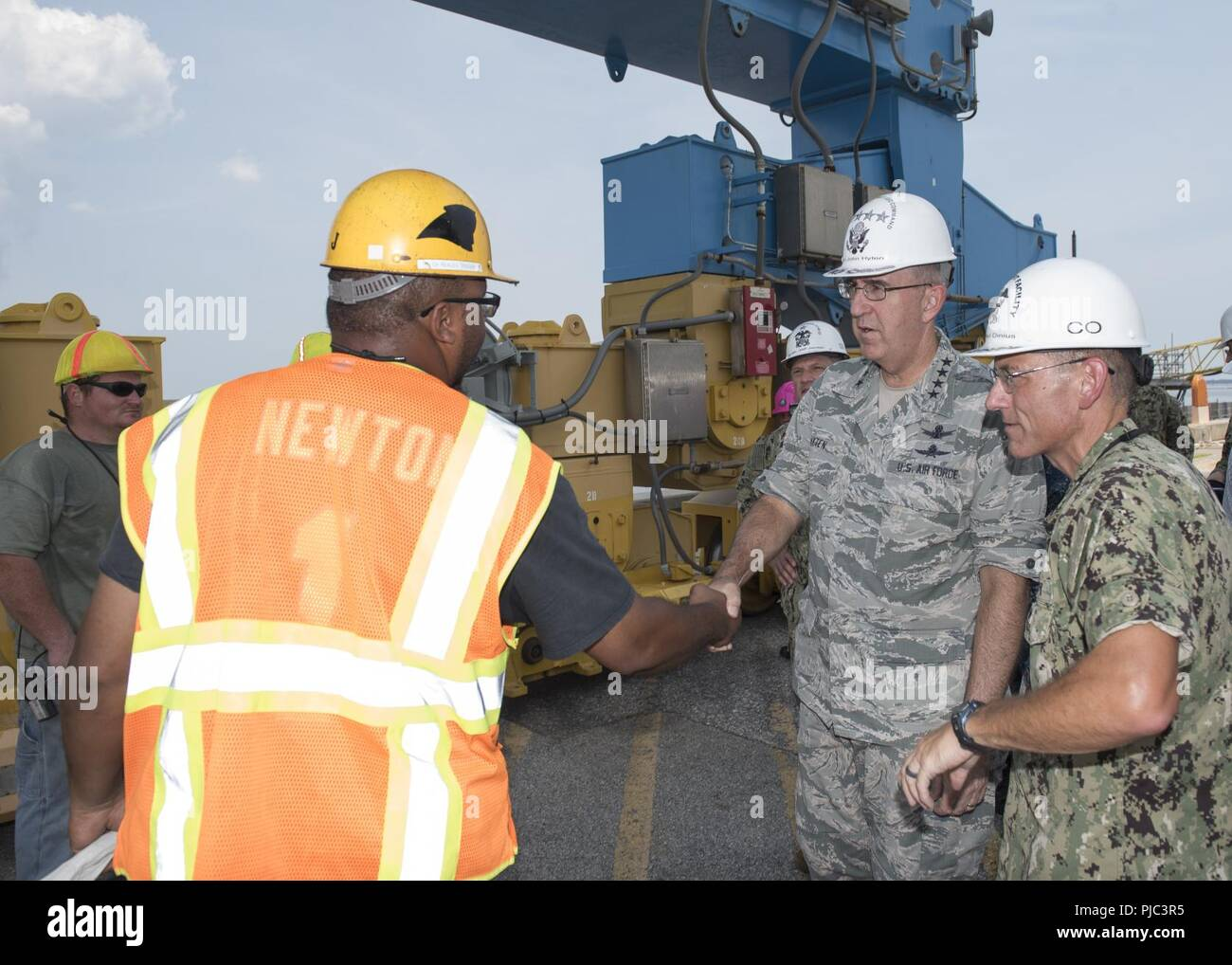Gen. John E. Hyten, commander, U.S. Strategic Command (USSTRATCOM), discusses submarine maintenance with employees at Naval Submarine Base Kings Bay, Ga. The base is home to six of the Ohio-class ballistic missile submarines that make up the most survivable leg of the nuclear triad and support strategic deterrence. - Stock Image