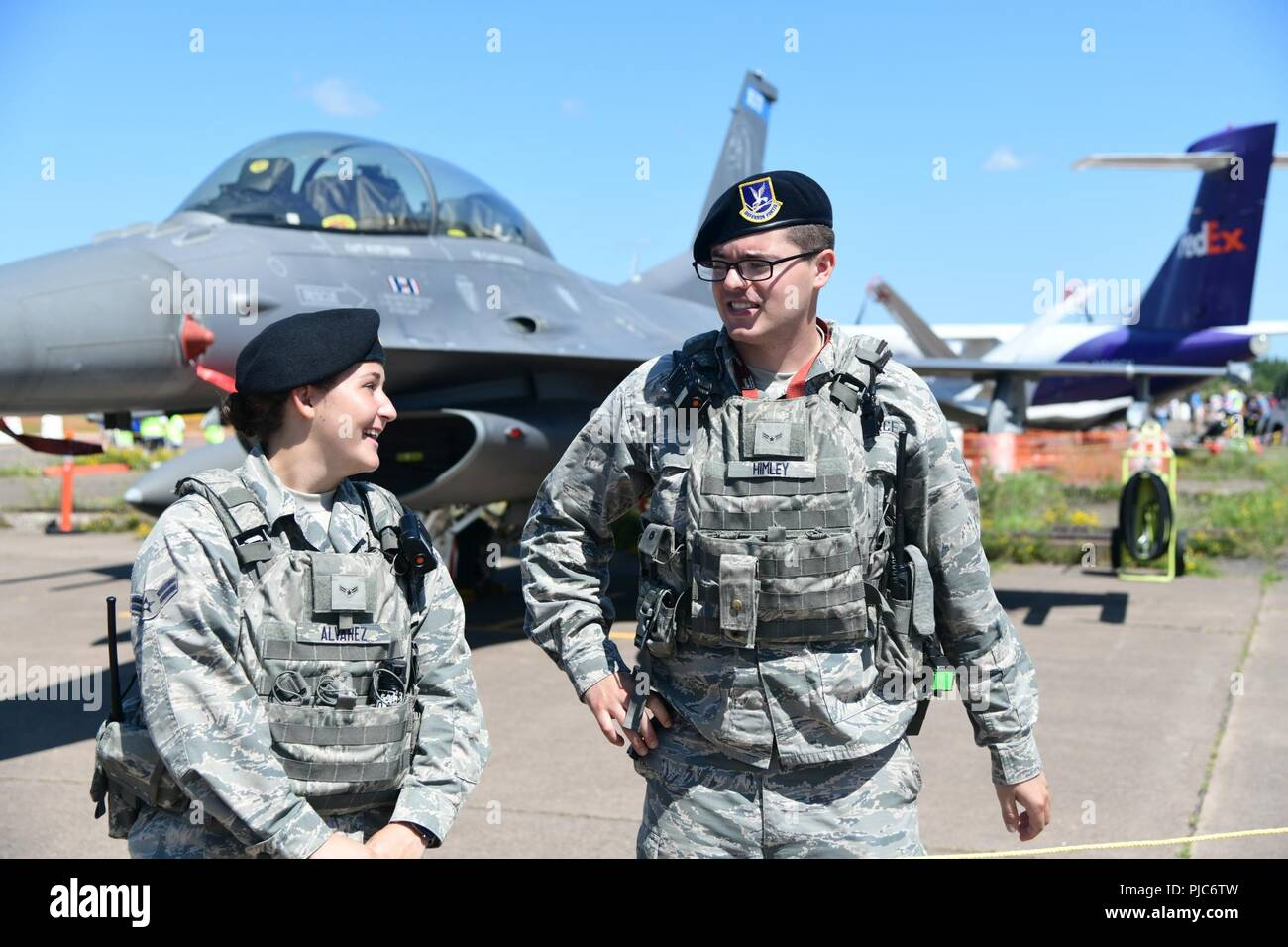 Two members of the 148th Security Forces Squadron provide