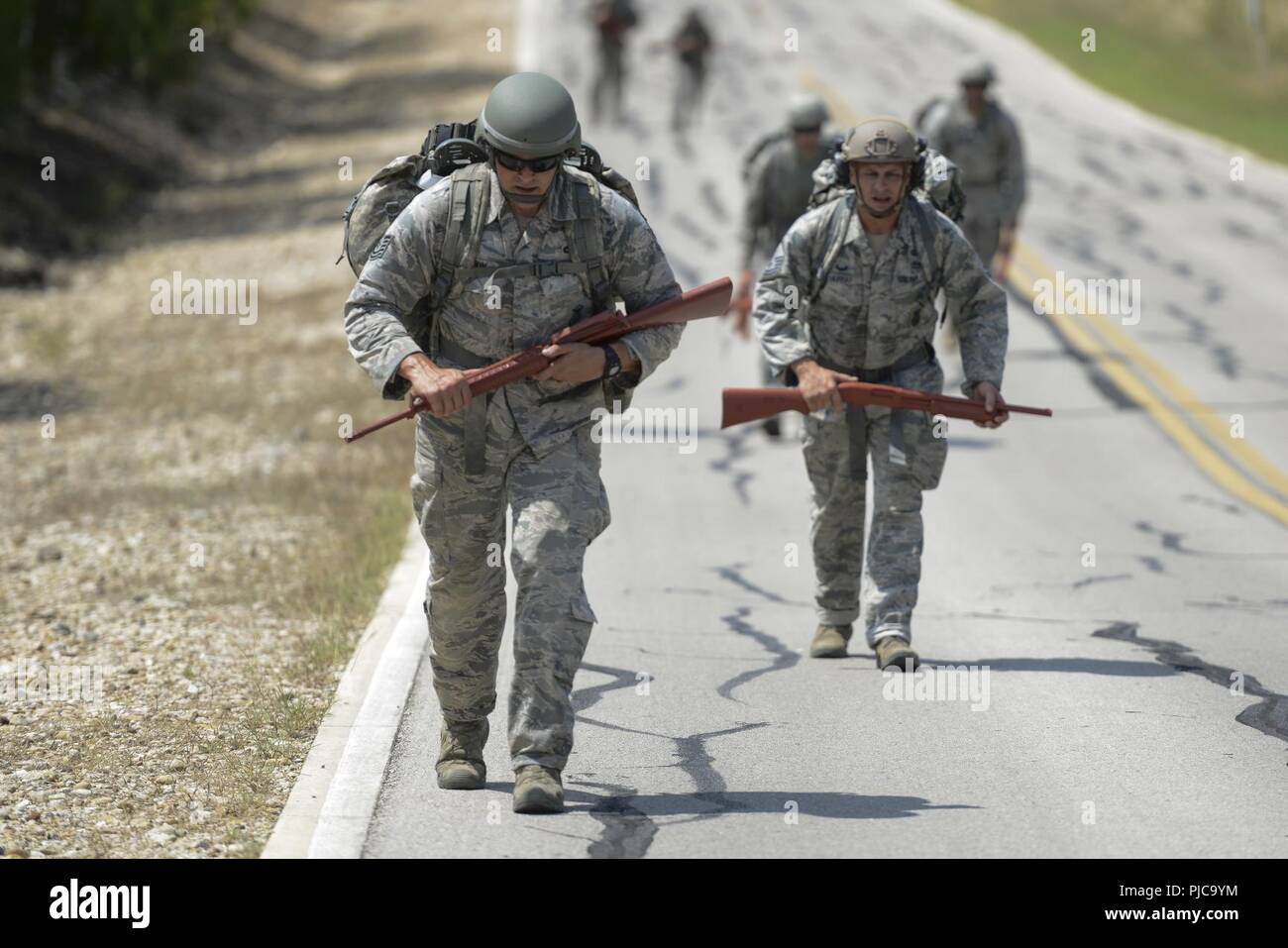 U S  Air Force Security Forces members run during the Air