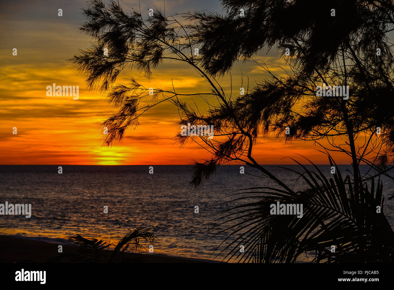 Sunset over West Philippine Sea - View from Ilocos Sur, Luzon, Philippines - Stock Image