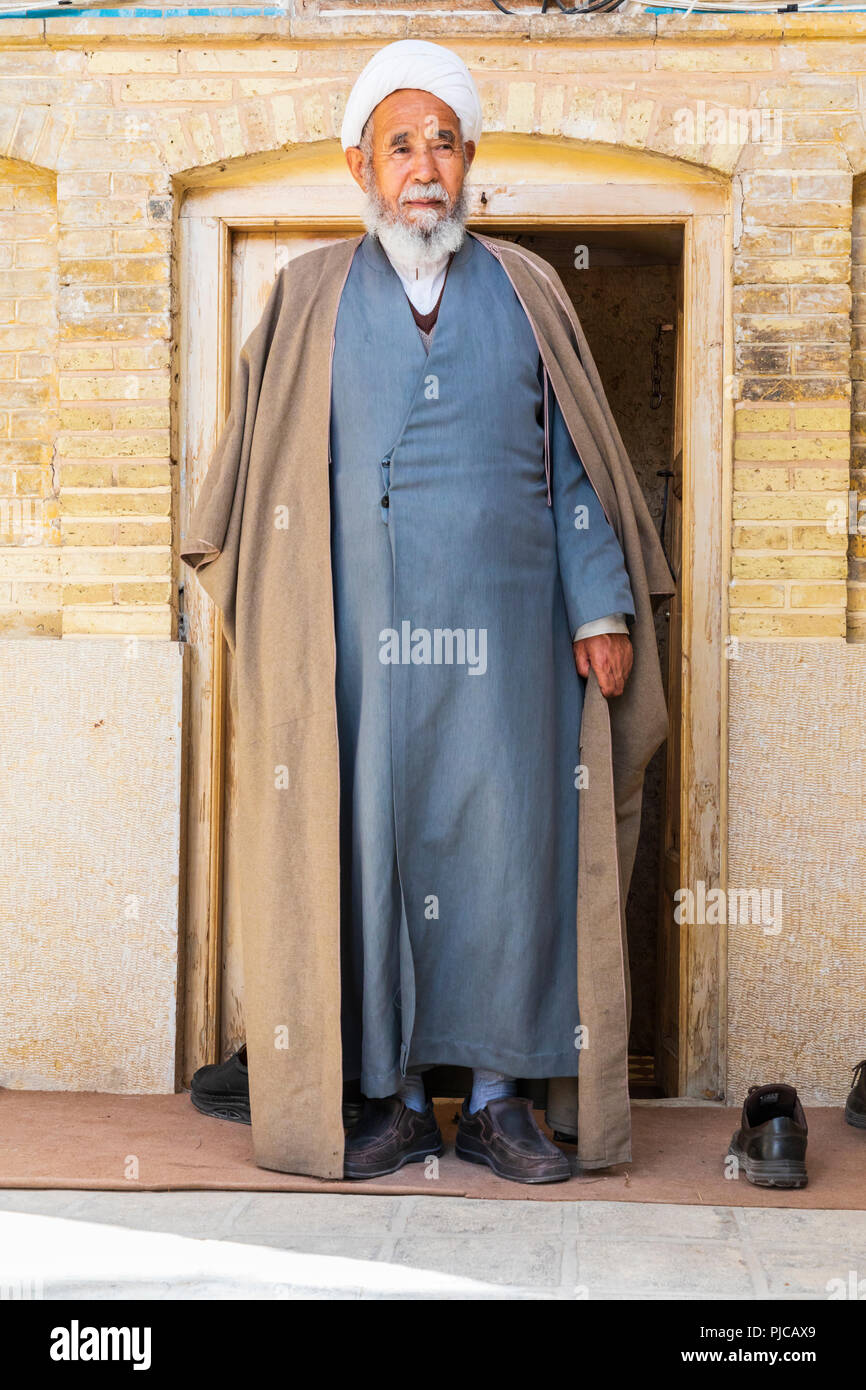 Islamic Republic of Iran. Shiraz. A Shiite Cleric leaving the Khan Madrassah.  March 08, 2018 - Stock Image