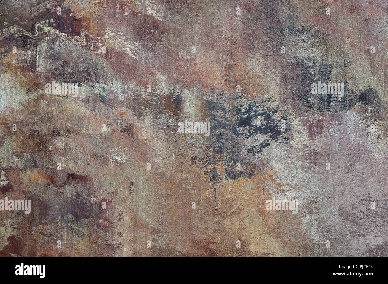 A stone effect abstract background texture with multiple blended and merging colours. Pink, purple, grey, gold and brown. - Stock Image