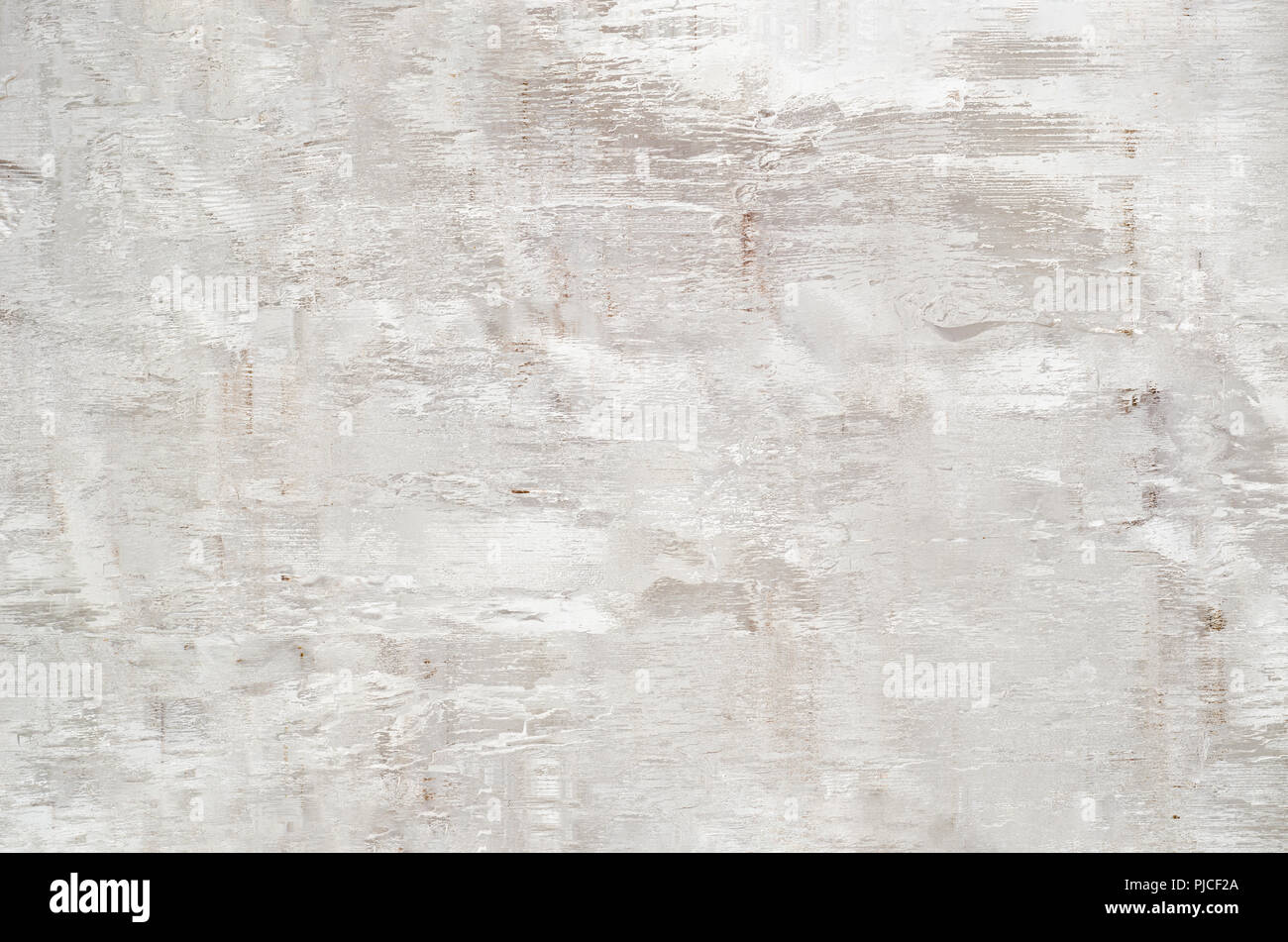 Abstract background of worn and dilapidated appearance. Warm white with a pink hue and woody elements in the texture. - Stock Image