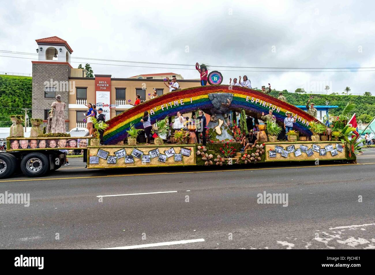 AGANA, Guam (July 21, 2018) Sailors assigned to the 30th Naval Construction Regiment (30 NCR) participate with the Village of Barrigada's and ride on their float during the 74th Anniversary celebration of Guam's Liberation Day. The Battle for Guam began July 21, 1944, when American forces invaded Guam to liberate it from the Japanese occupiers. Barrigada is 30 NCR's Sister Village, which is a partnership between the village and command for community service and outreach opportunities. (US. Navy Stock Photo
