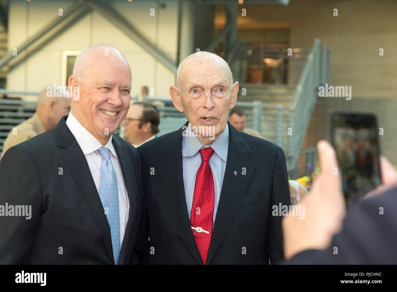 Richard L. Alderson, general manager of the New York Mets baseball team, and James A. Gillcrist, record setting high jumper, pose for a photo during the 2018 United States Marine Corps Sports Hall of Fame Induction Ceremony at the National Museum of the Marine Corps, Triangle, Va., July 18, 2018. The event was held for the induction of it's three newest members including both James A. Gillcrist and Richard L. Alderson, as well as Theodore A. Lyons. - Stock Image