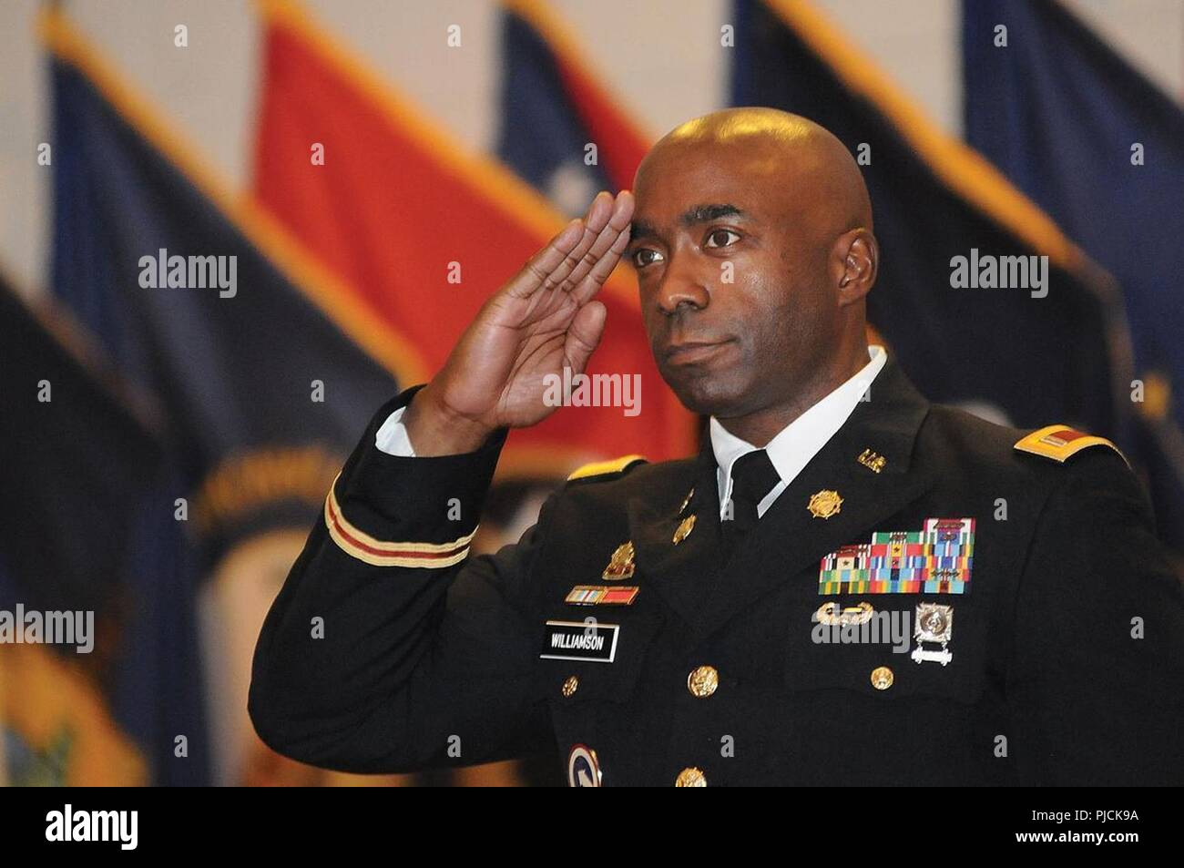 Chief Warrant Officer 5 Jermain C. Williamson Sr., the new Transportation Corps Regimental Warrant Officer, salutes during the Trans. Corps RWO Change of Command Ceremony July 16 at Wylie Hall. Williamson succeeded CWO 5 Donald E. Berg Jr. - Stock Image