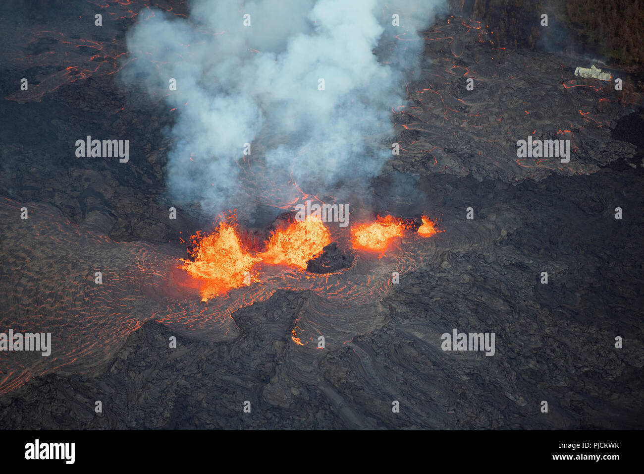 lava emanating from Pu'u O'o on Kilauea Volcano, erupts in three fountains from a fissure in Leilani Estates subdivision, near Pahoa, Puna, Hawaii ( t - Stock Image