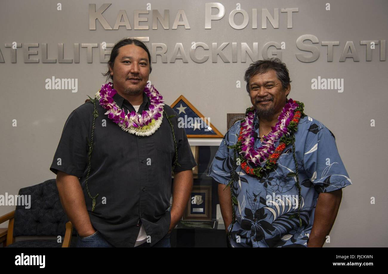 Jason Fukumoto, Detachment 3, 21st Space Operations Squadron electrician, and Robin Albios, Det. 3, 21st SOPS heating, ventilation and air conditioning specialist, pose for a photo after receiving the Air Force Civilian Award for Valor at the Kaena Point Satellite Tracking Station, Hawaii, July 23, 2018. Two years ago, Fukumoto and Albios provided medical aid to a state of Hawaii volunteer field crew member who suffered from smoke inhalation during a fire at the Kuaokala Game Management Area. - Stock Image