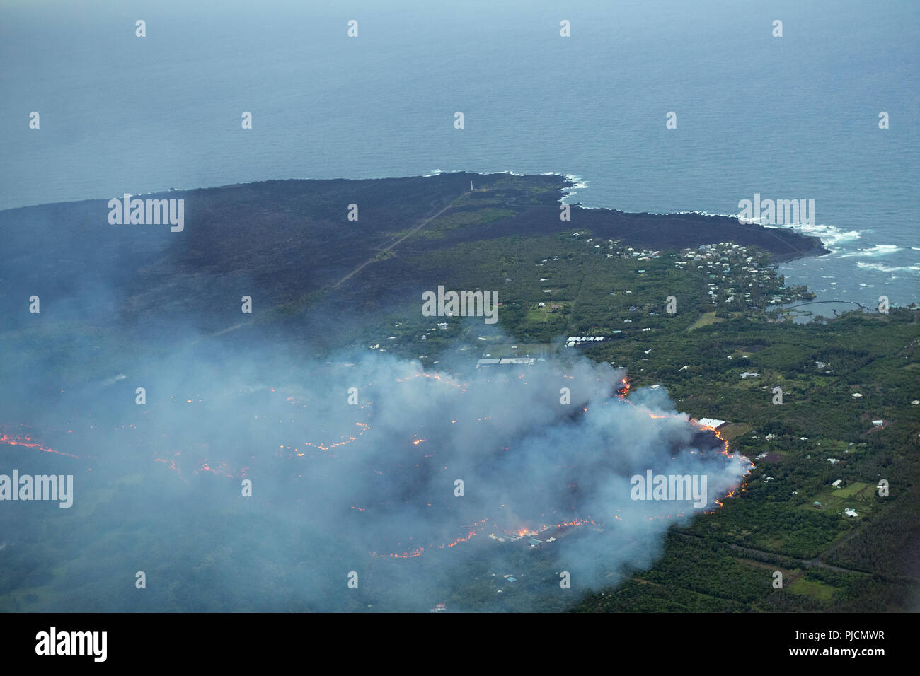 lava originating from Kilauea Volcano, erupting from fissure 8 in Leilani Estates, near Pahoa, flows through lower Puna District into Kapoho, approach - Stock Image