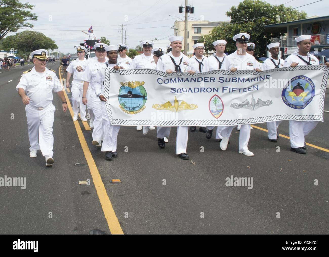 HAGATNA, Guam (July 21, 2018) – Sailors from Commander, Submarine Squadron 15 carry a banner during Guam's annual Liberation Day Parade in Hagatna, Guam, July 21. The 2018 Guam Liberation Parade celebrates the 74th anniversary of the liberation of Guam from Japanese occupation by U.S. forces during World War II. - Stock Image
