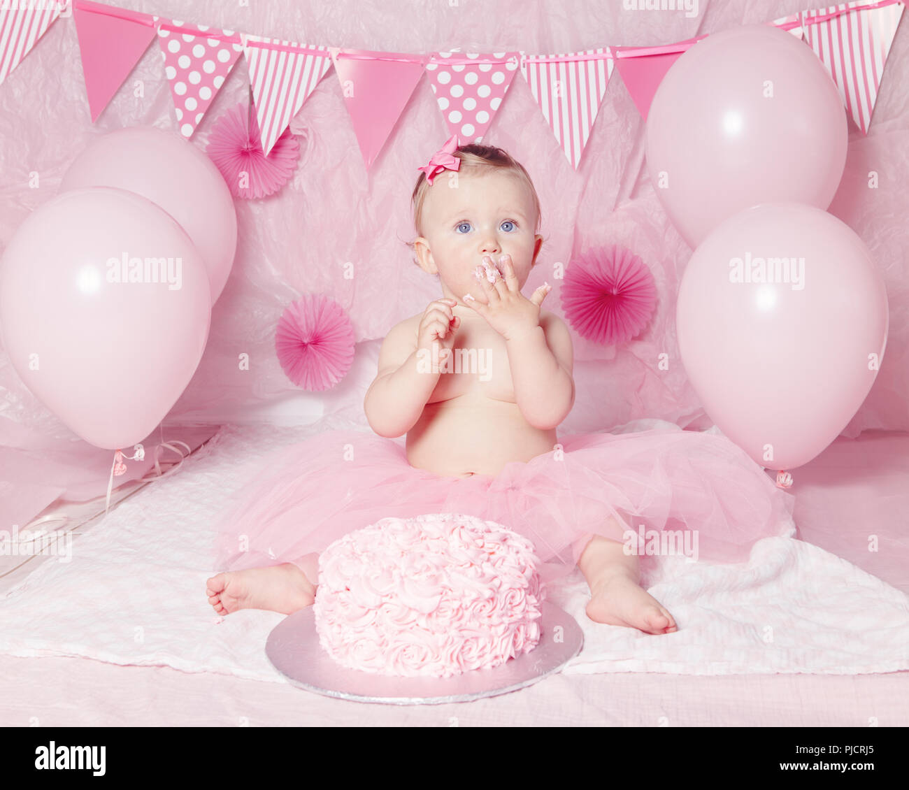 Portrait Of Cute Adorable Caucasian Baby Girl With Blue Eyes In Pink Tutu Skirt Celebrating Her