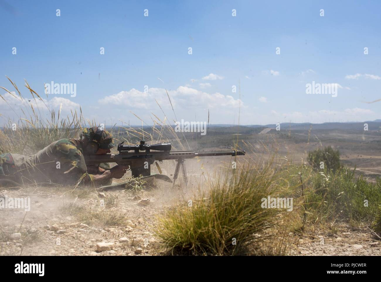 the muzzle blast from a belgian sniper s barrett m82 50 caliber