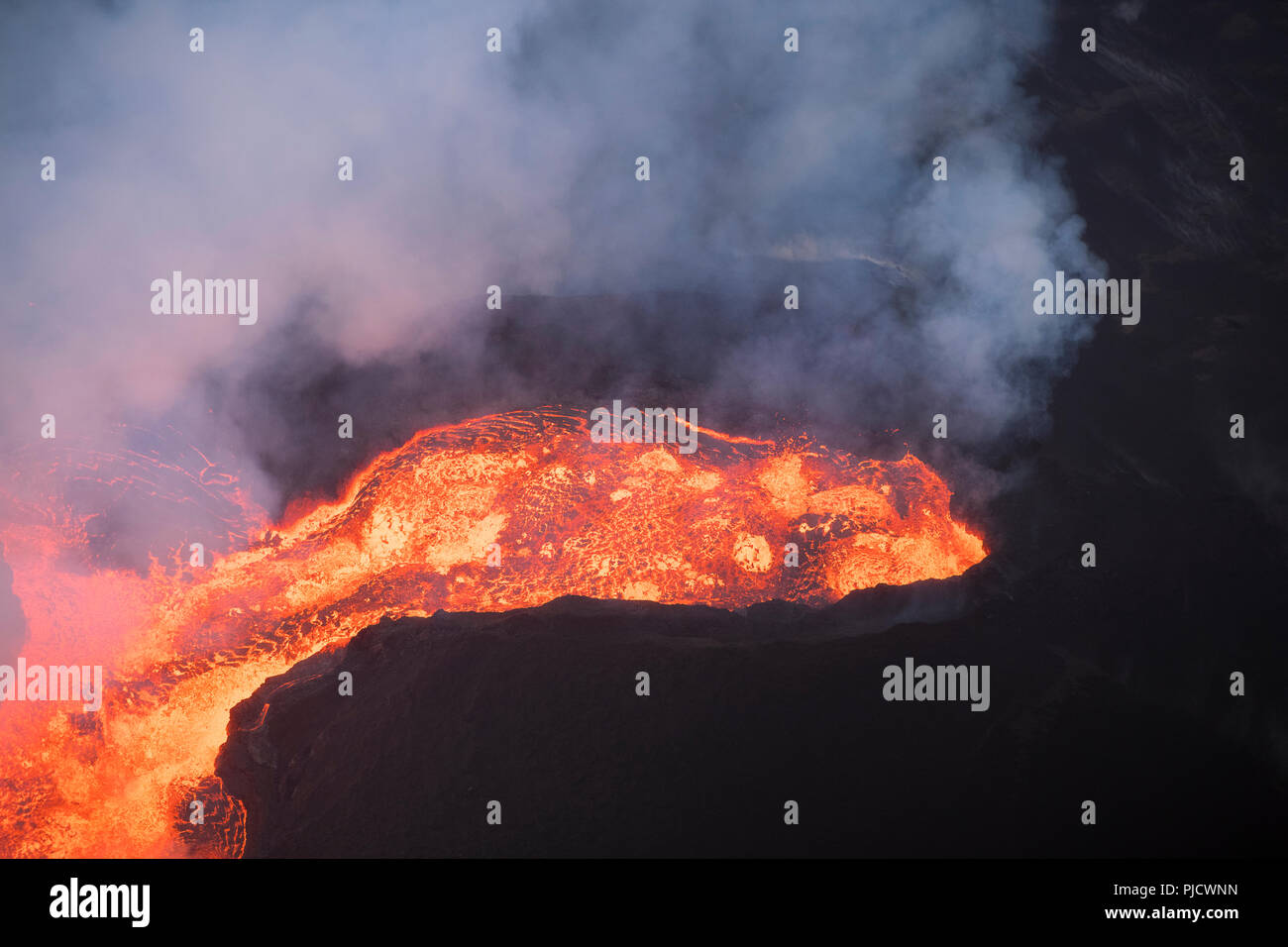 Aerial view of lava boiling out of Fissure 8 of the Kilauea Volcano east rift zone in Leilani Estates subdivision near the town of Pahoa, Hawaii - Stock Image